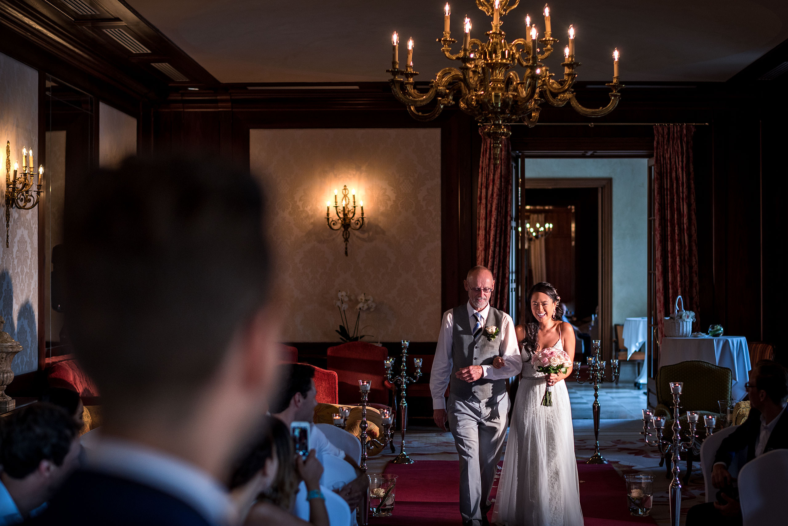 dad walking his daughter down the isle at castillo hotel son vida destination wedding by sean leblanc
