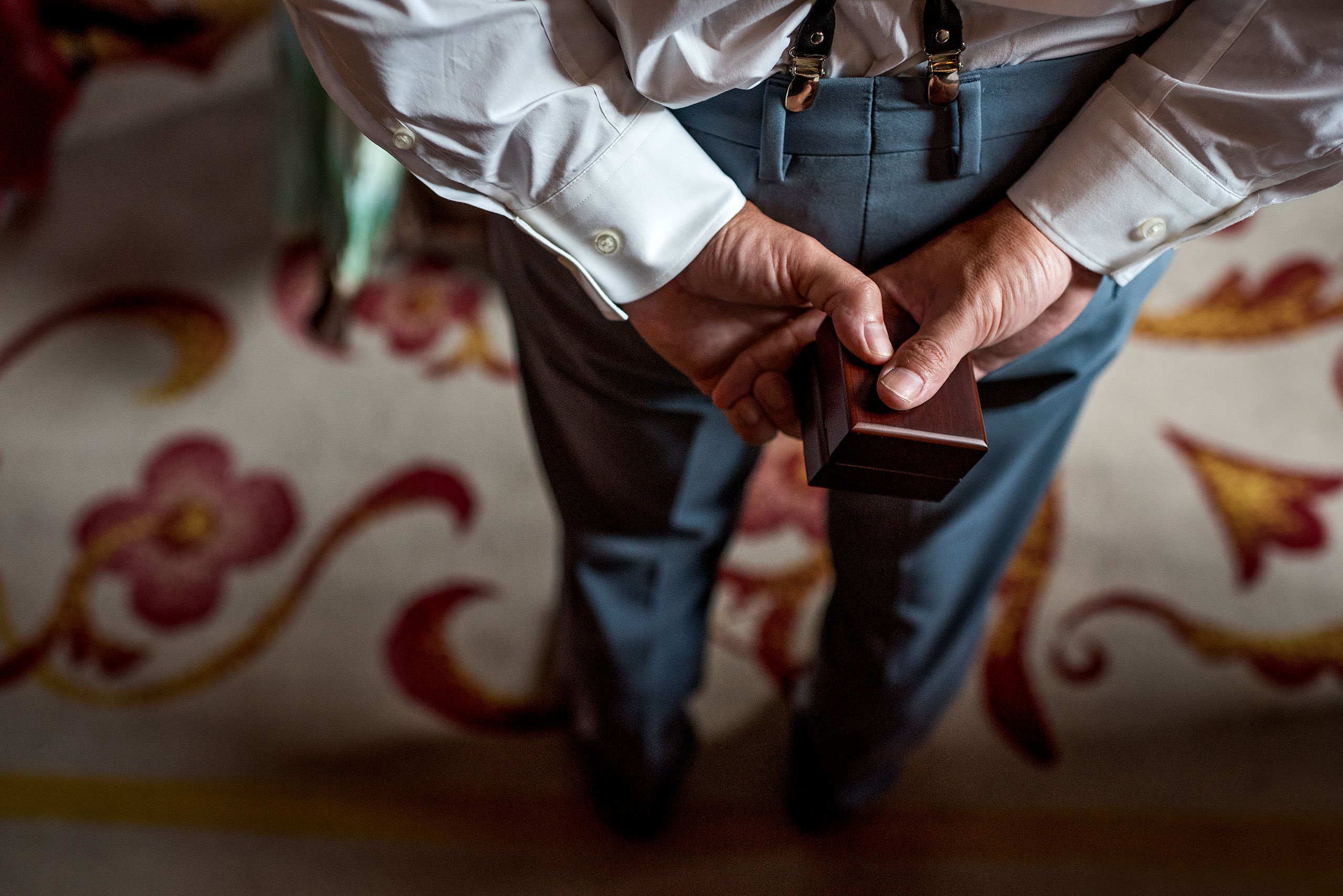 best man holding the rings behind his back at castillo hotel son vida destination wedding by sean leblanc