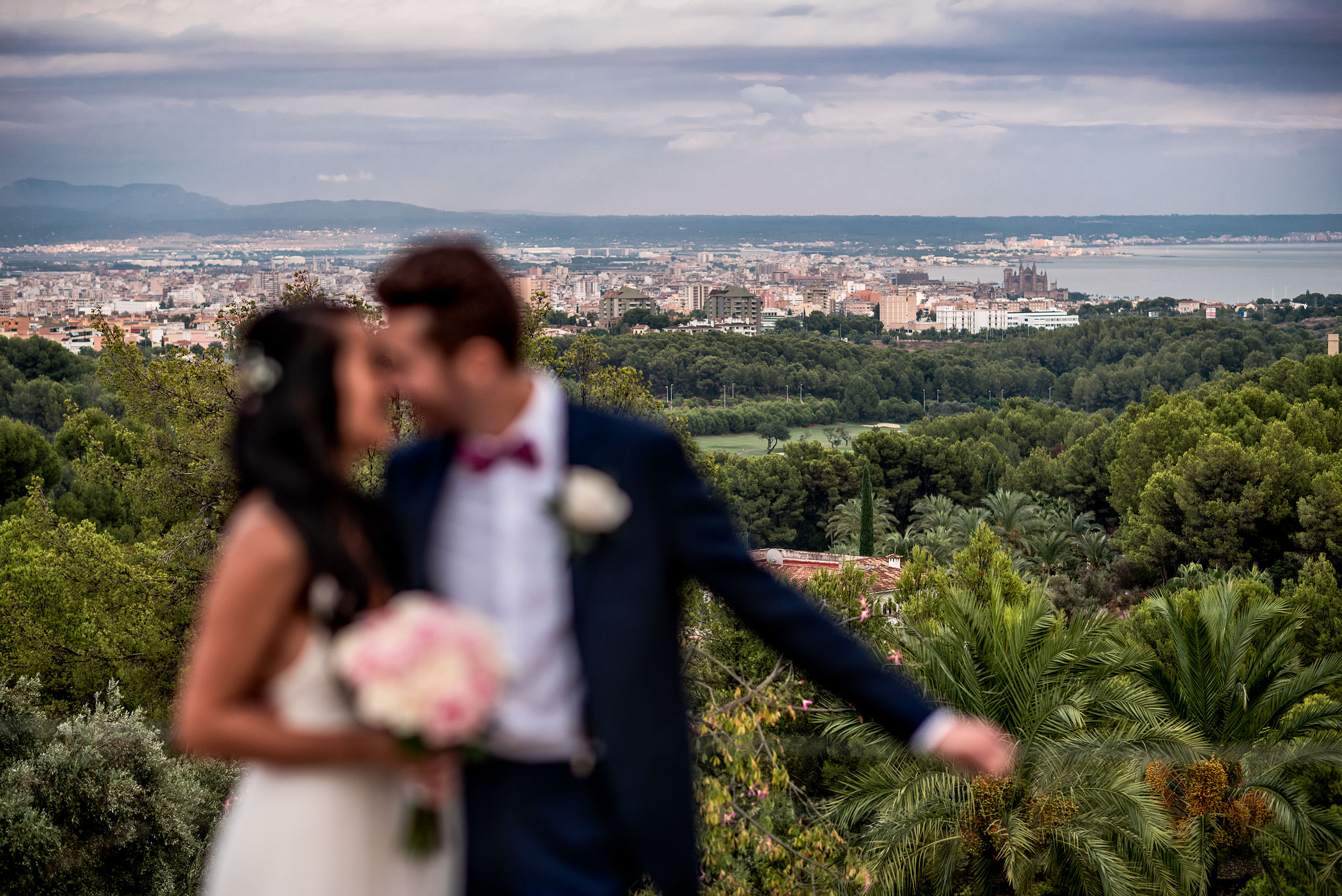 bride and groom with city in the background at castillo hotel son vida destination wedding by sean leblanc
