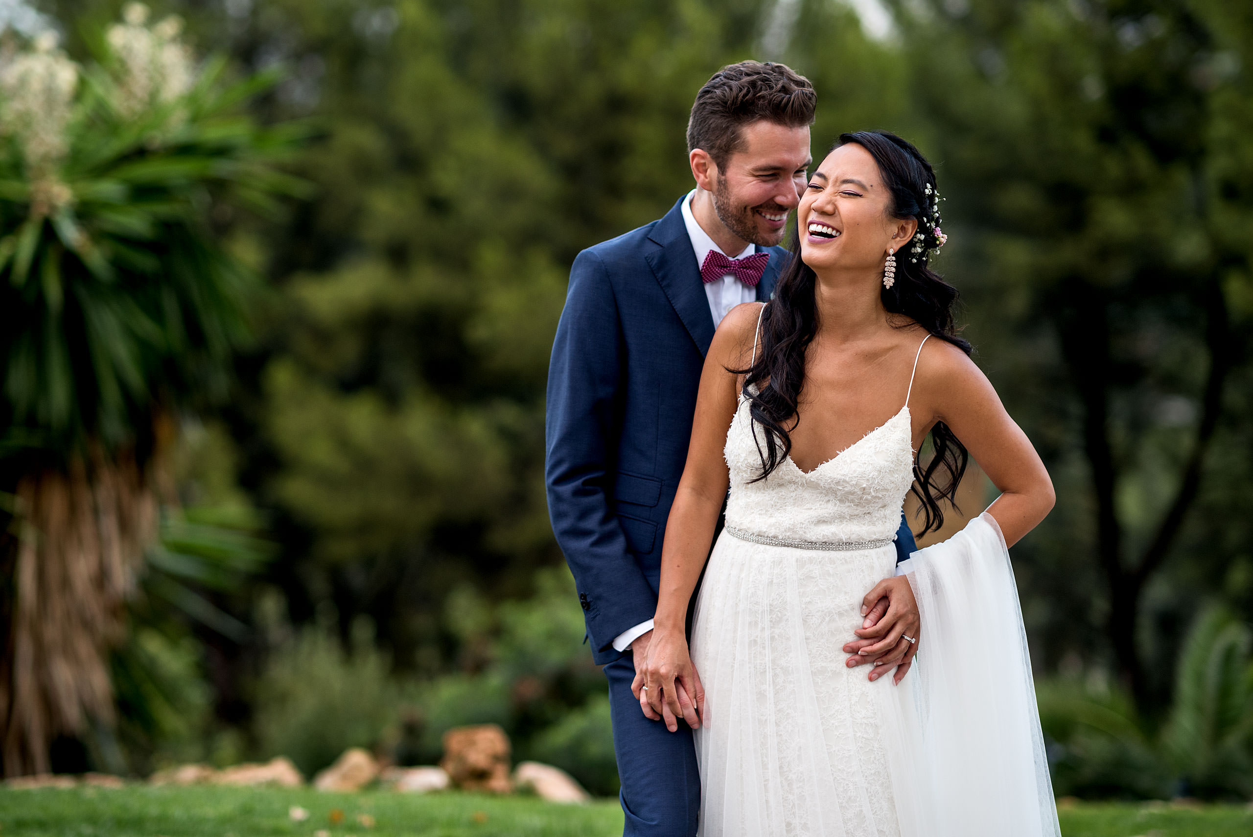 a bride and groom laughing together at castillo hotel son vida destination wedding by sean leblanc