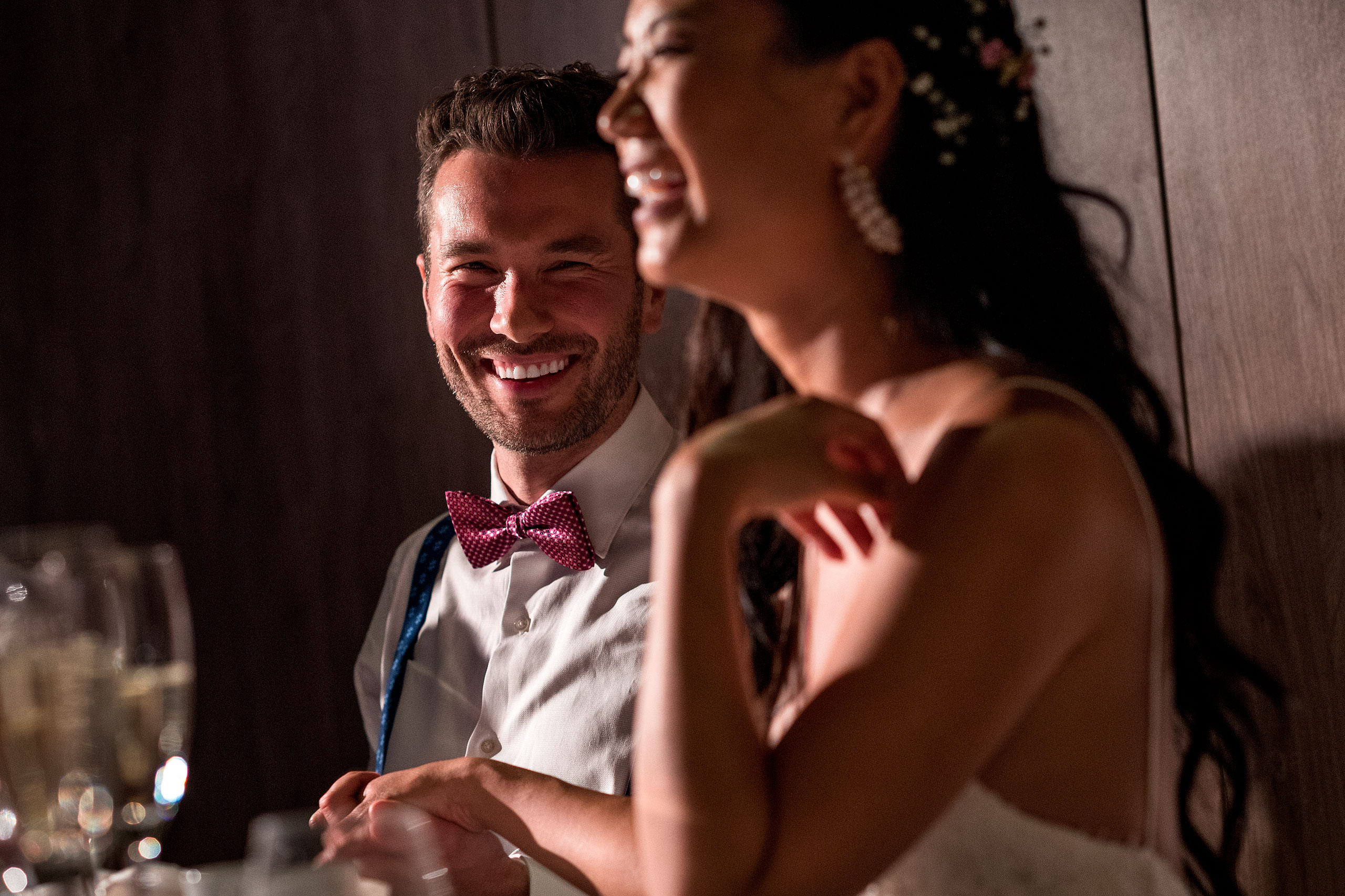 a groom smiling at his bride at castillo hotel son vida destination wedding by sean leblanc