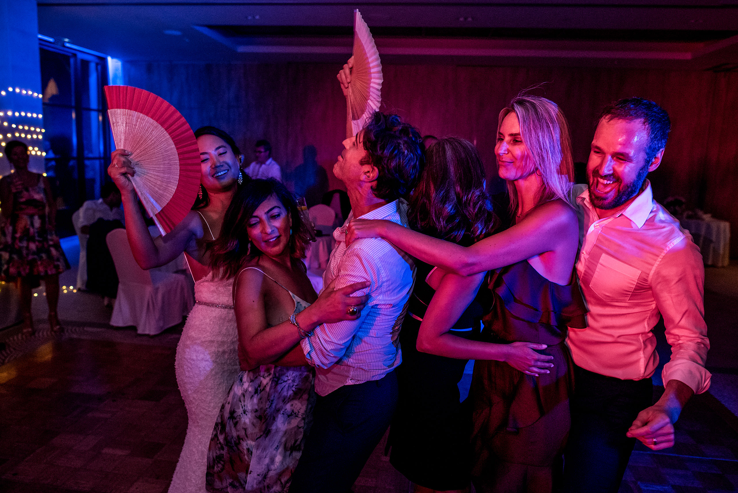 five people dancing together at castillo hotel son vida destination wedding by sean leblanc