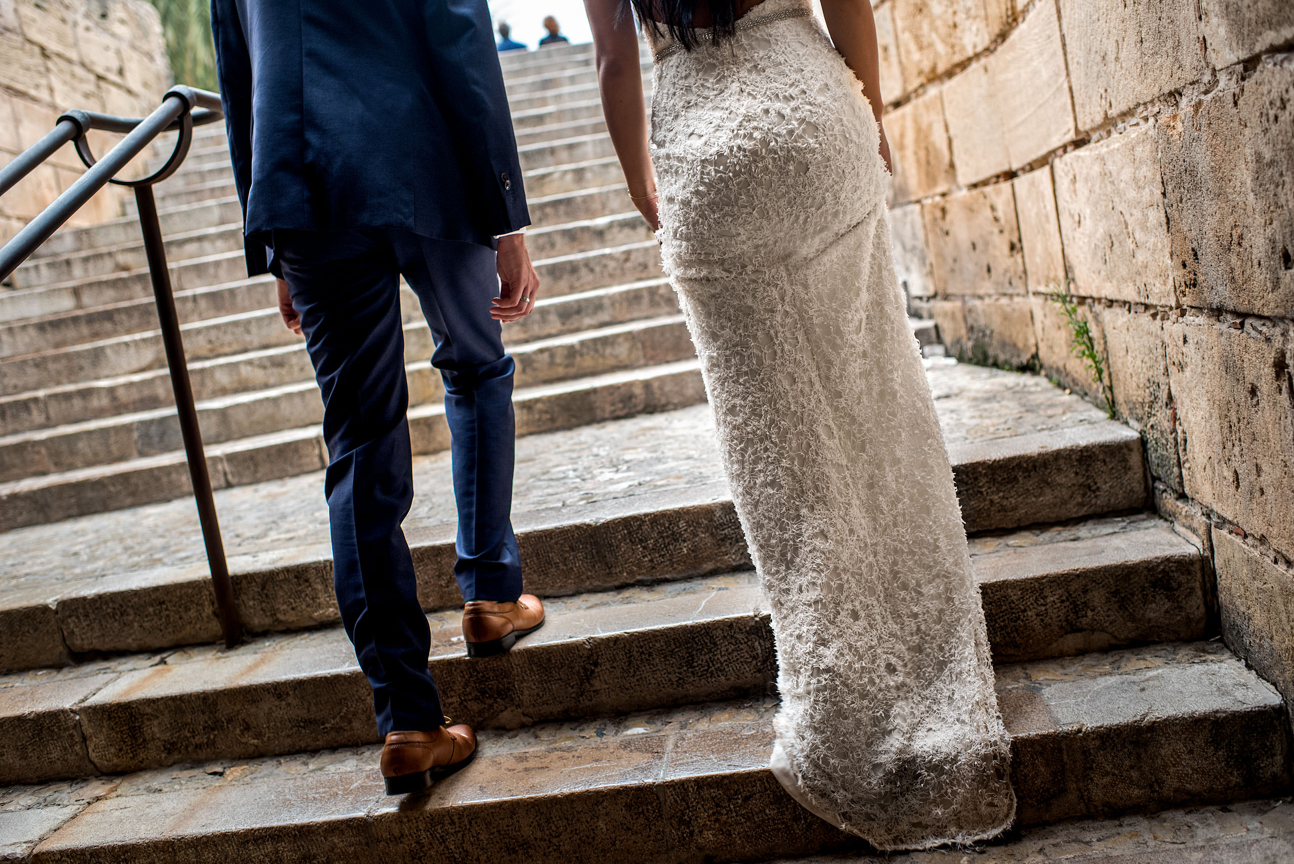 a bride and groom walking up stairs at castillo hotel son vida destination wedding by sean leblanc