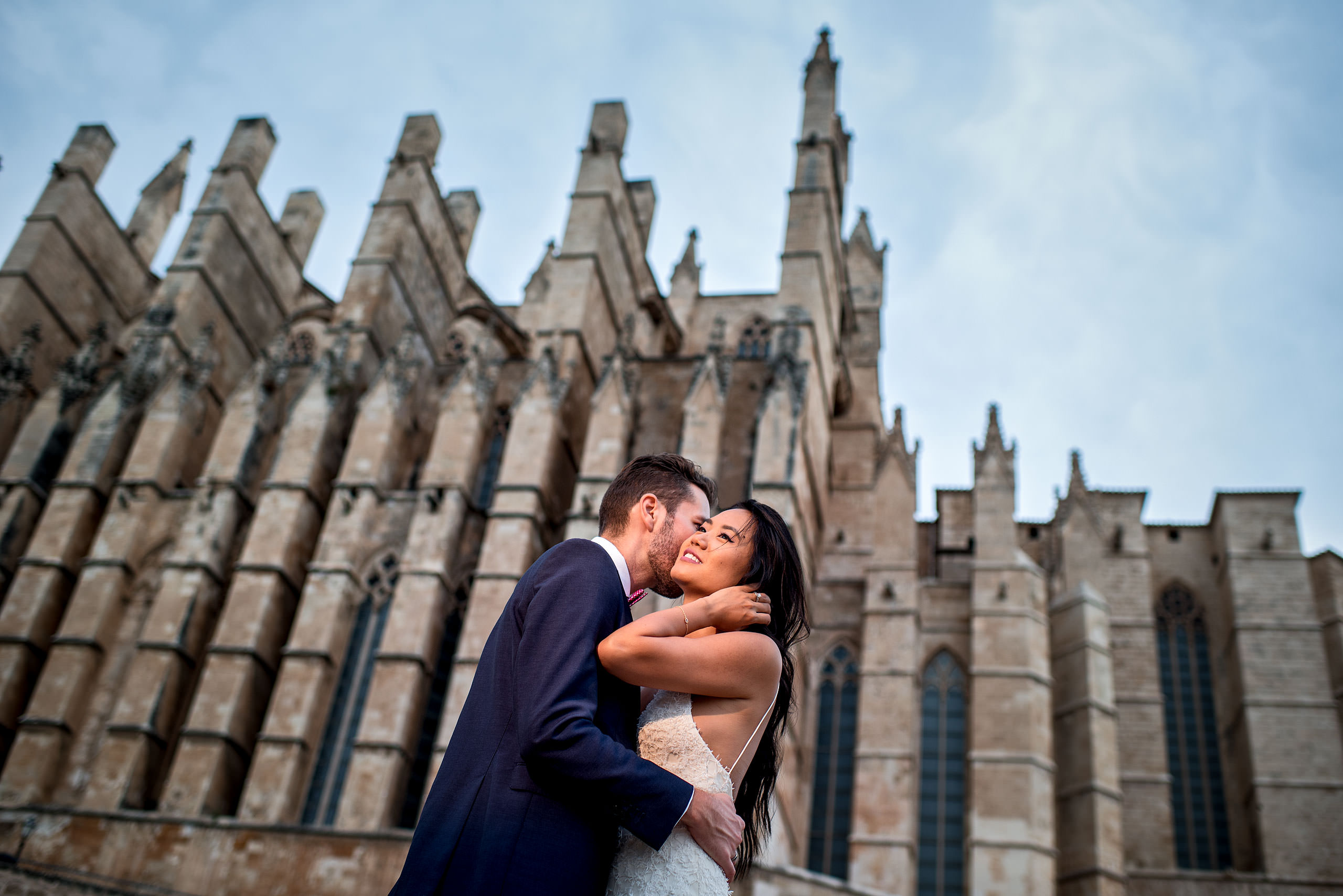 a bride and groom in front of the Palma cathedral at castillo hotel son vida destination wedding by sean leblanc