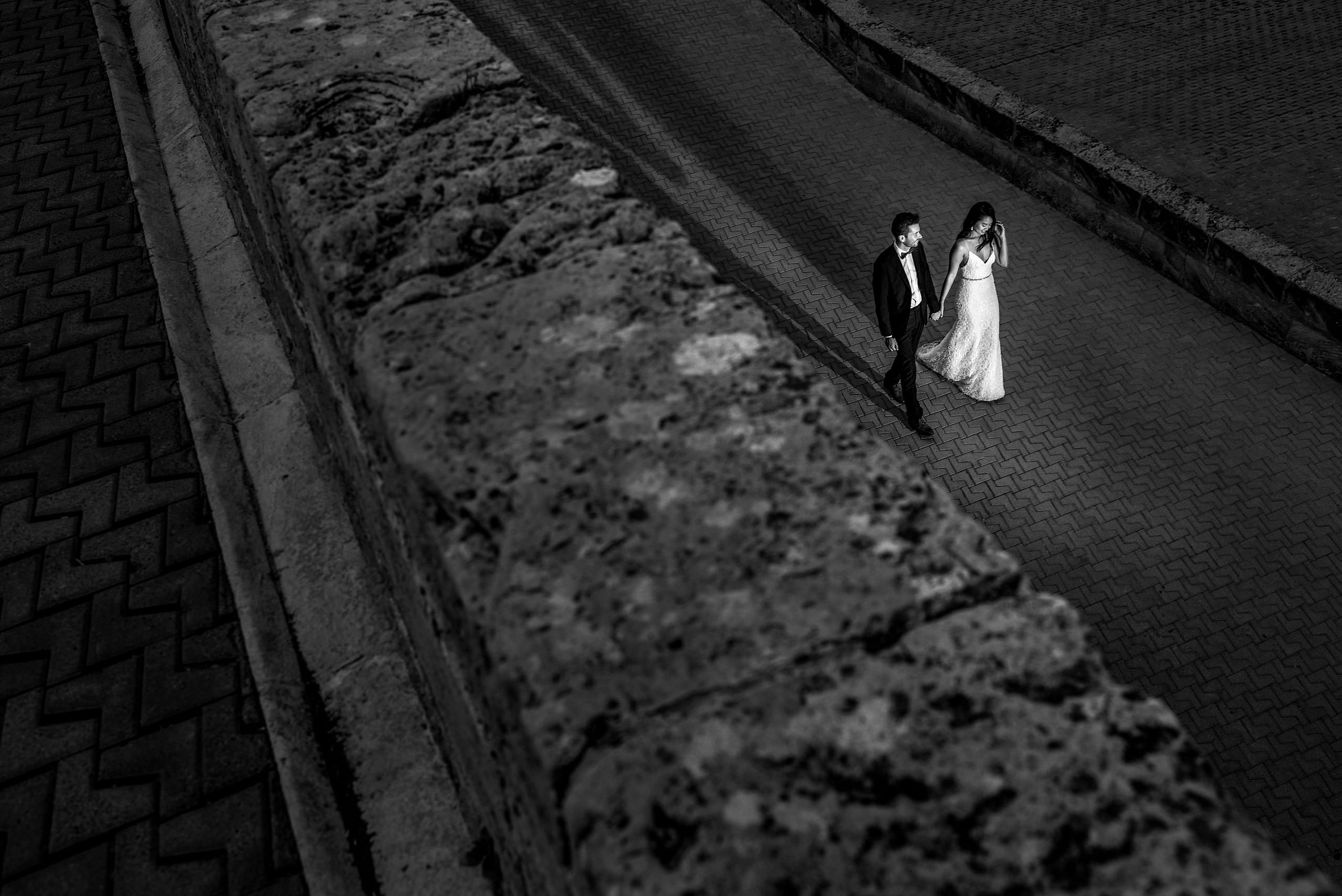 a bride and groom walking up a ramp at castillo hotel son vida destination wedding by sean leblanc