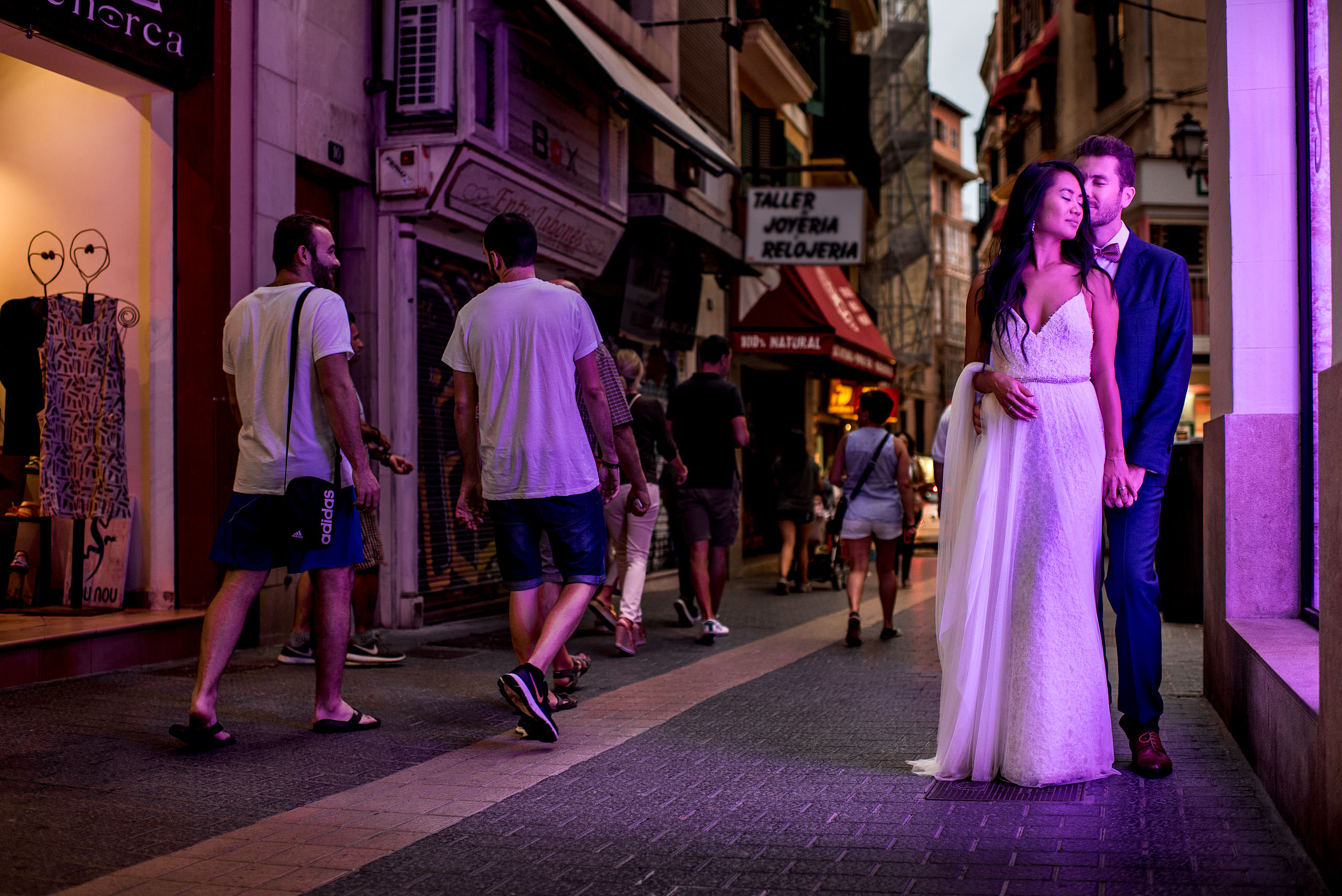 a bride and groom in the city of Palma at castillo hotel son vida destination wedding by sean leblanc