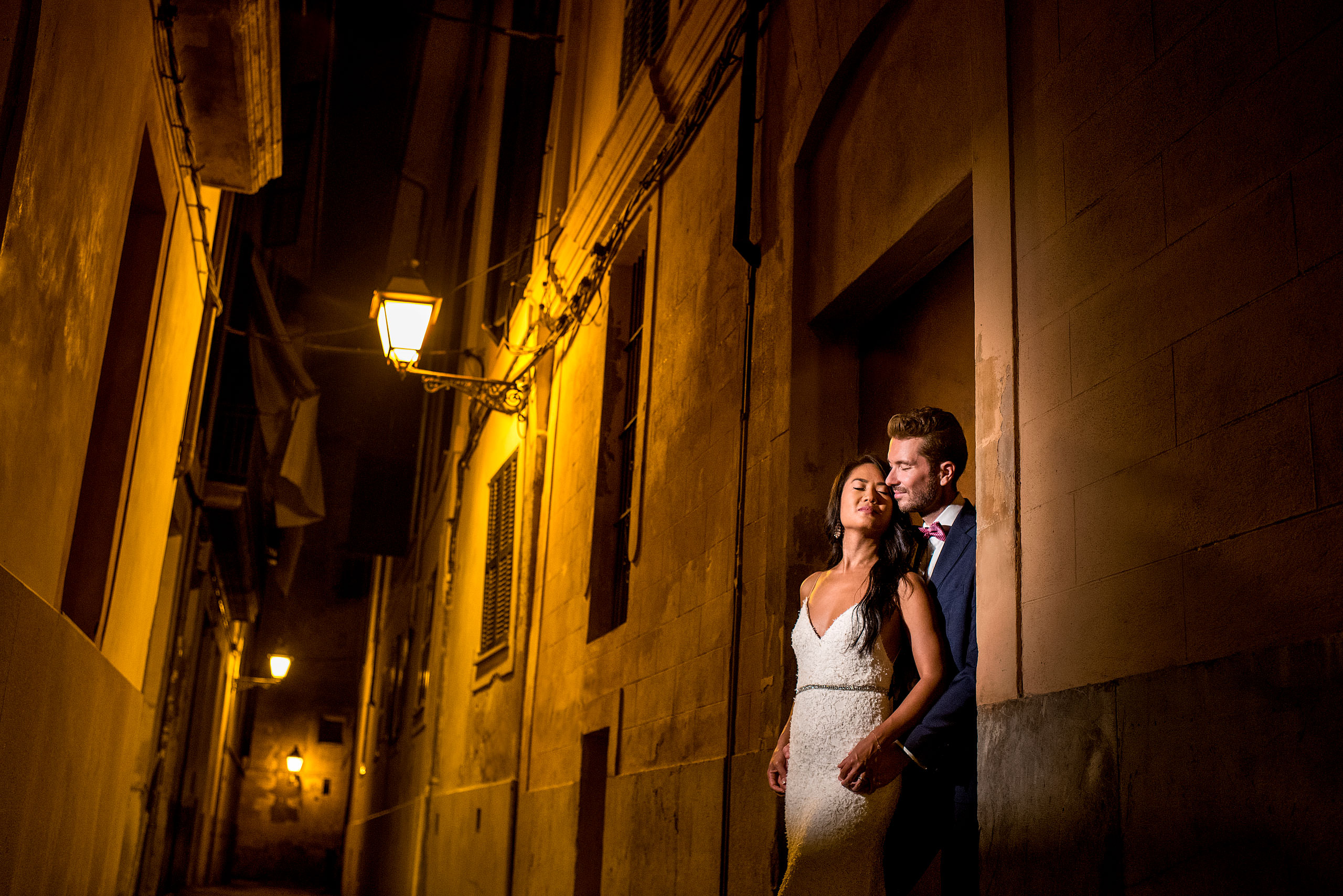 a bride and groom in the alley of Palma at castillo hotel son vida destination wedding by sean leblanc
