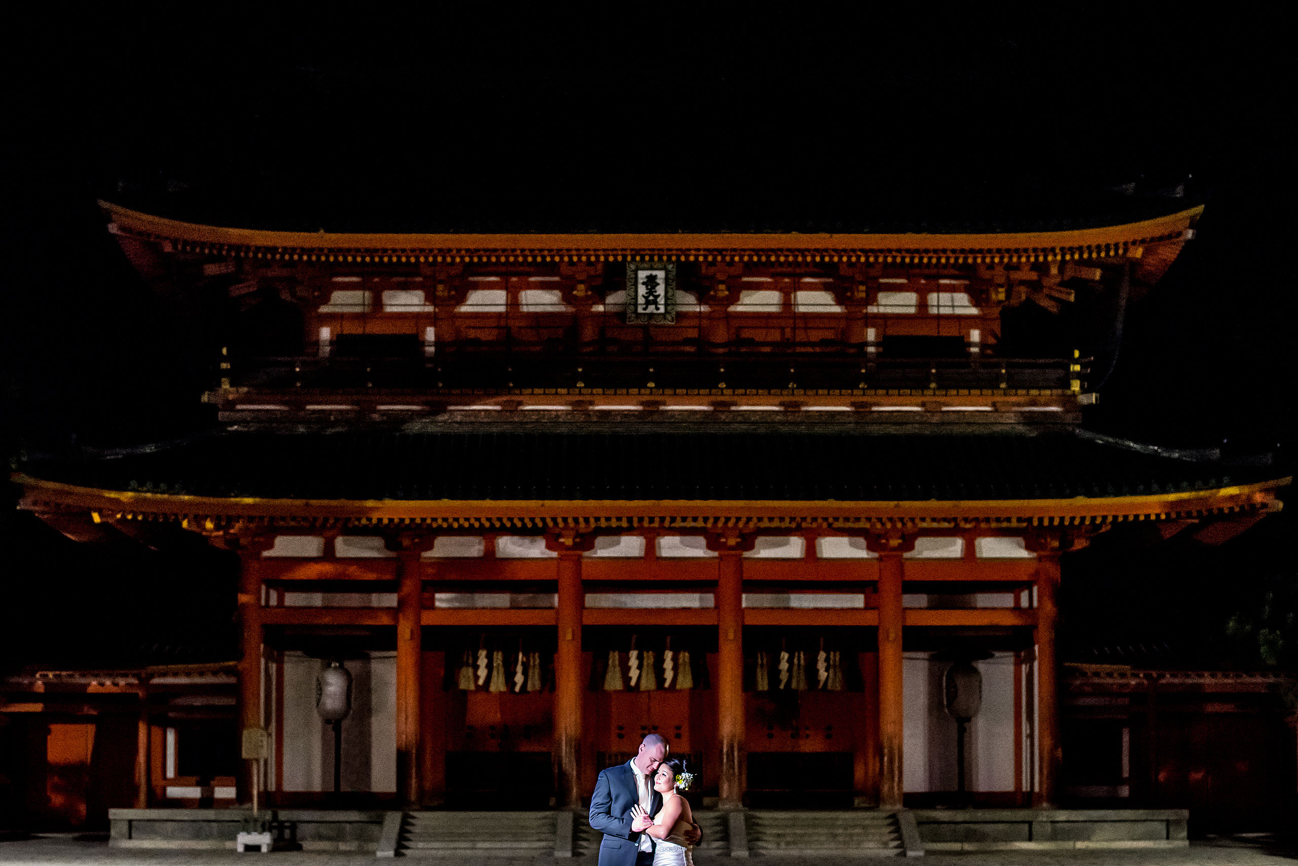 a bride and groom in front of a Japanese temple by Japan Destination Wedding Photographer Sean LeBlanc