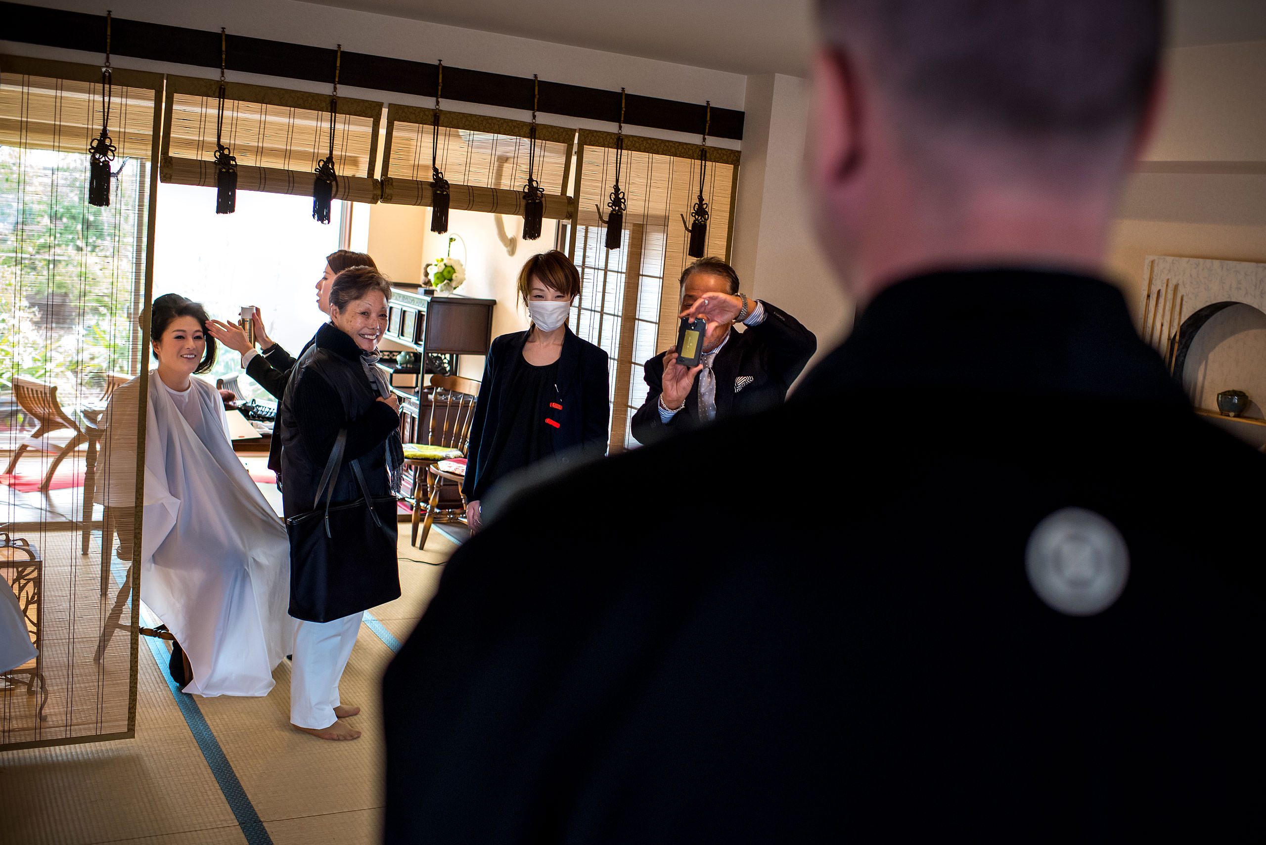a Japanese family smiling at a groom by Japan Destination Wedding Photographer Sean LeBlanc
