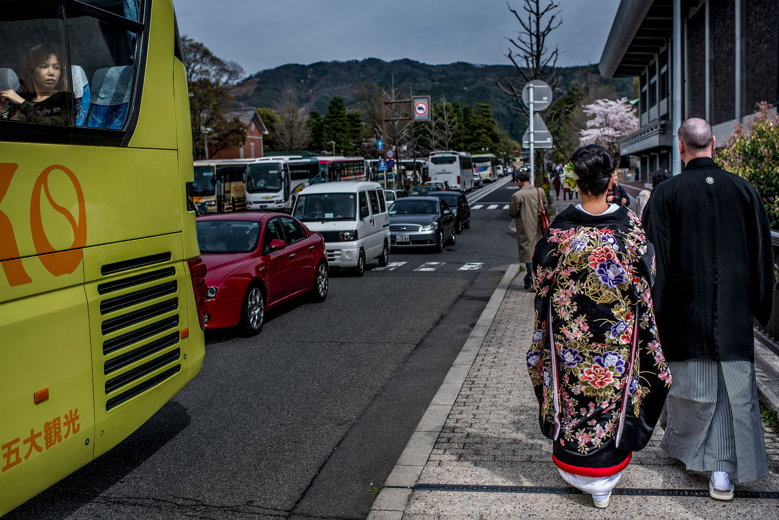 a Japanese bride and groom walking down the street by Japan Destination Wedding Photographer Sean LeBlanc