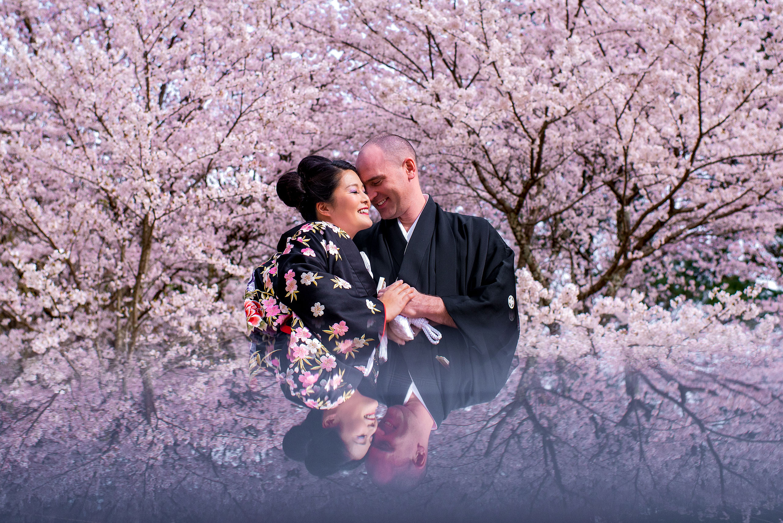 a Japanese bride and groom in front of a cherry blossom tree by Japan Destination Wedding Photographer Sean LeBlanc