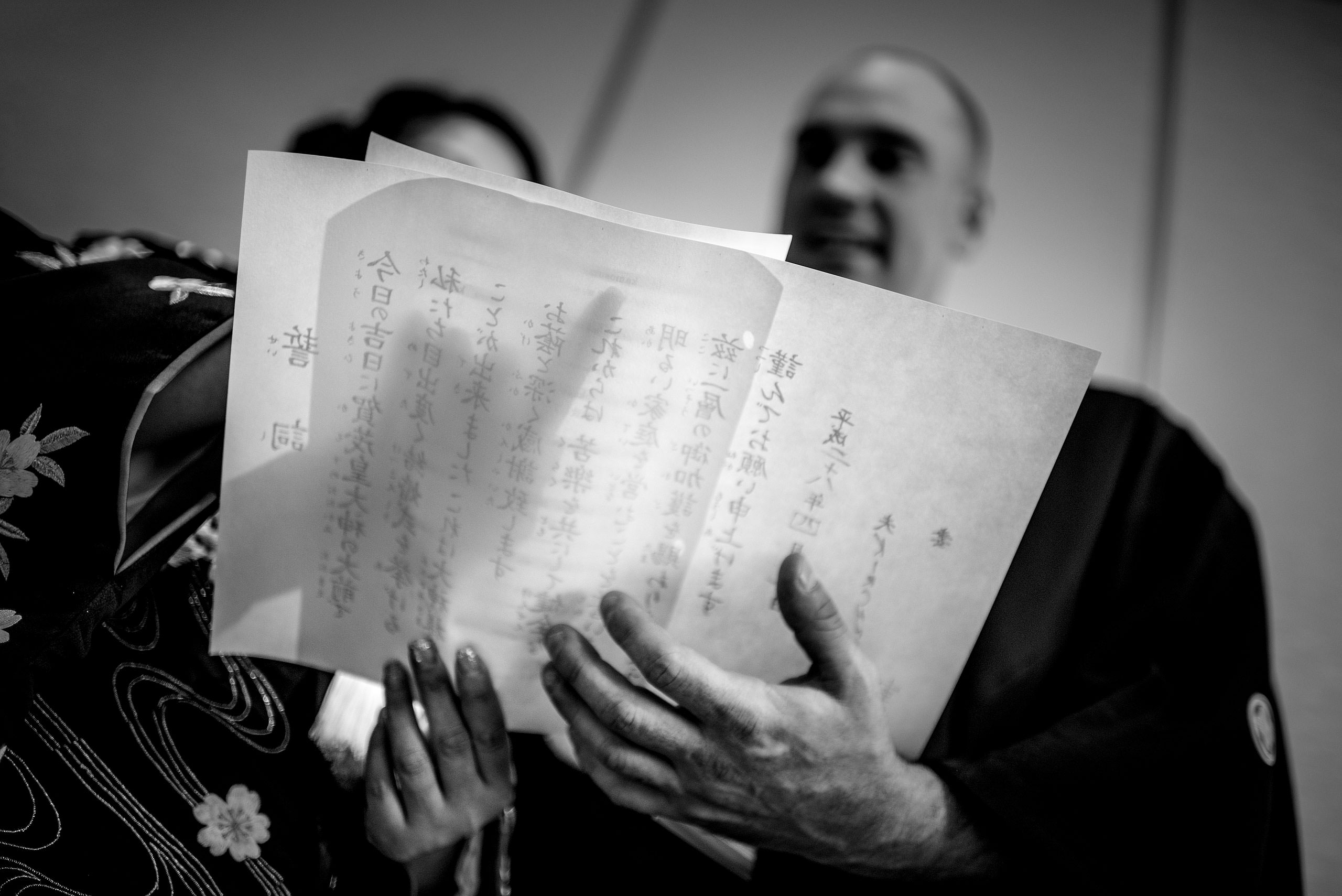 a Japanese bride and groom reading a document by Japan Destination Wedding Photographer Sean LeBlanc