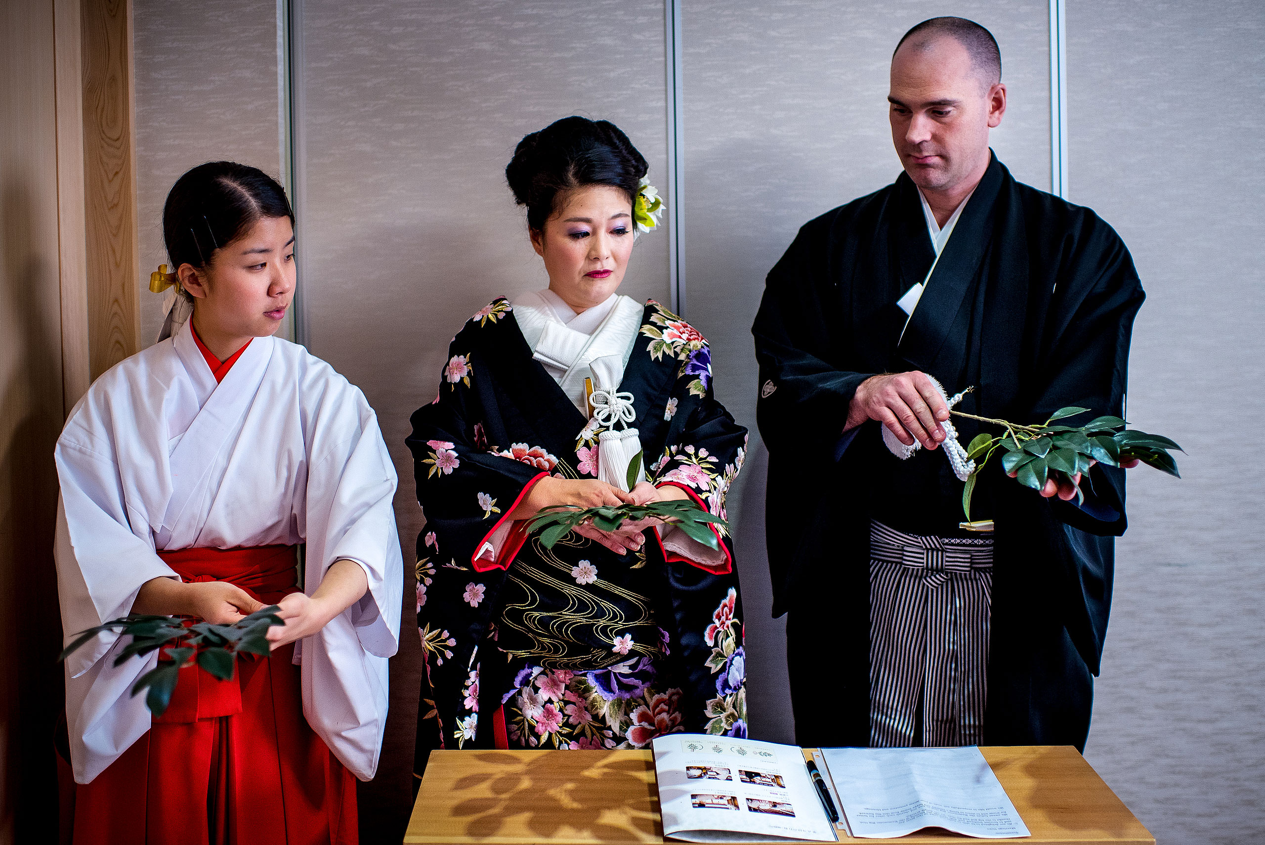 a Japanese bride and groom getting ready before thier wedding ceremony by Japan Destination Wedding Photographer Sean LeBlanc