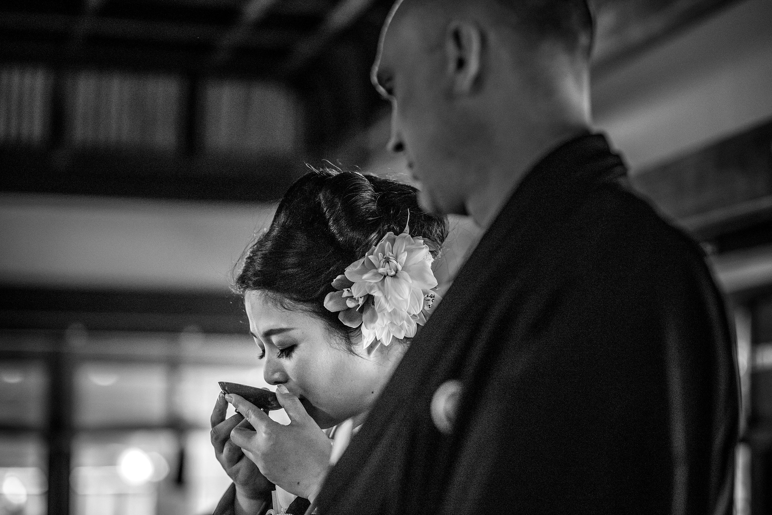 a Japanese women drinking from a cup by Japan Destination Wedding Photographer Sean LeBlanc