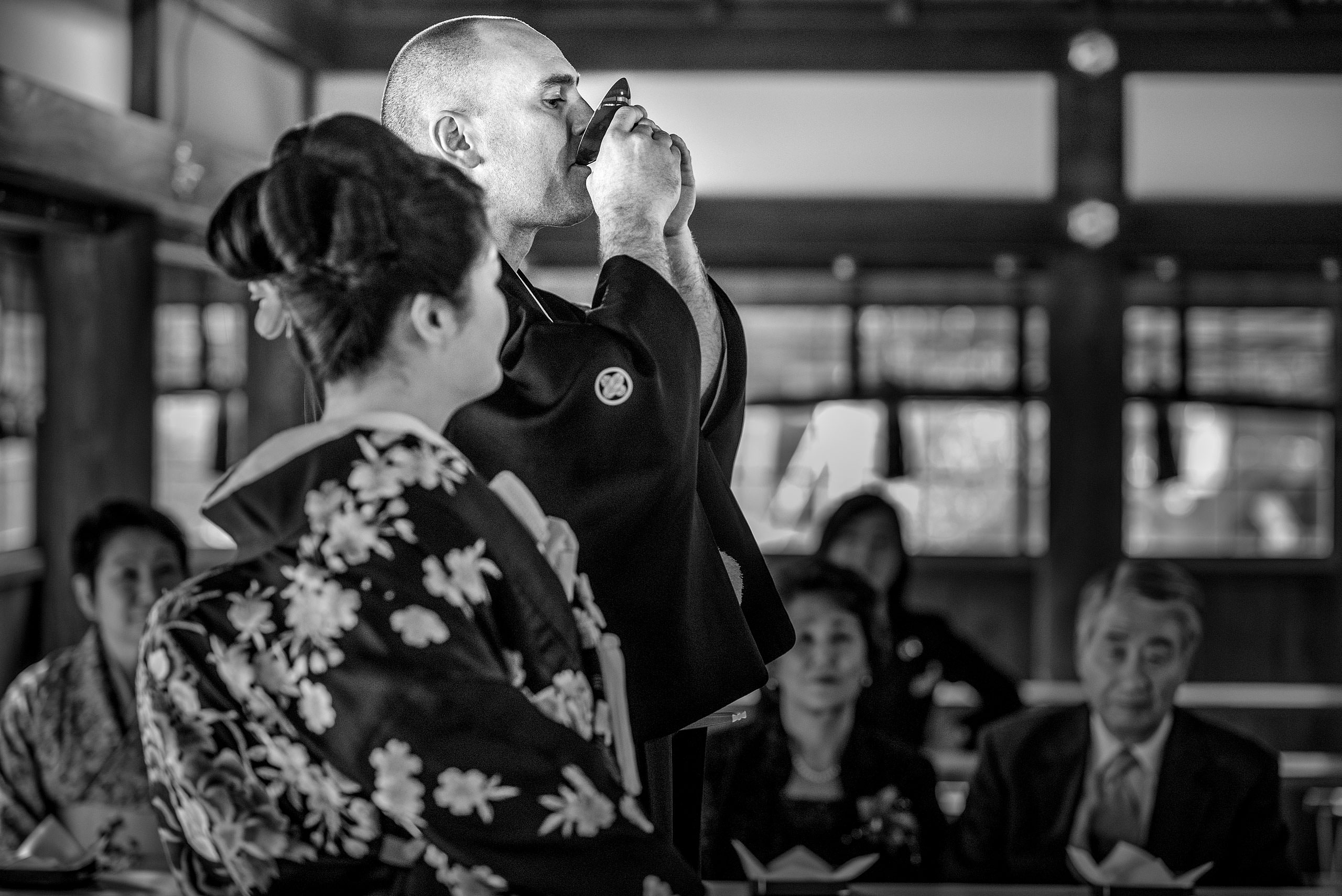 a groom drinking from a cup by Japan Destination Wedding Photographer Sean LeBlanc