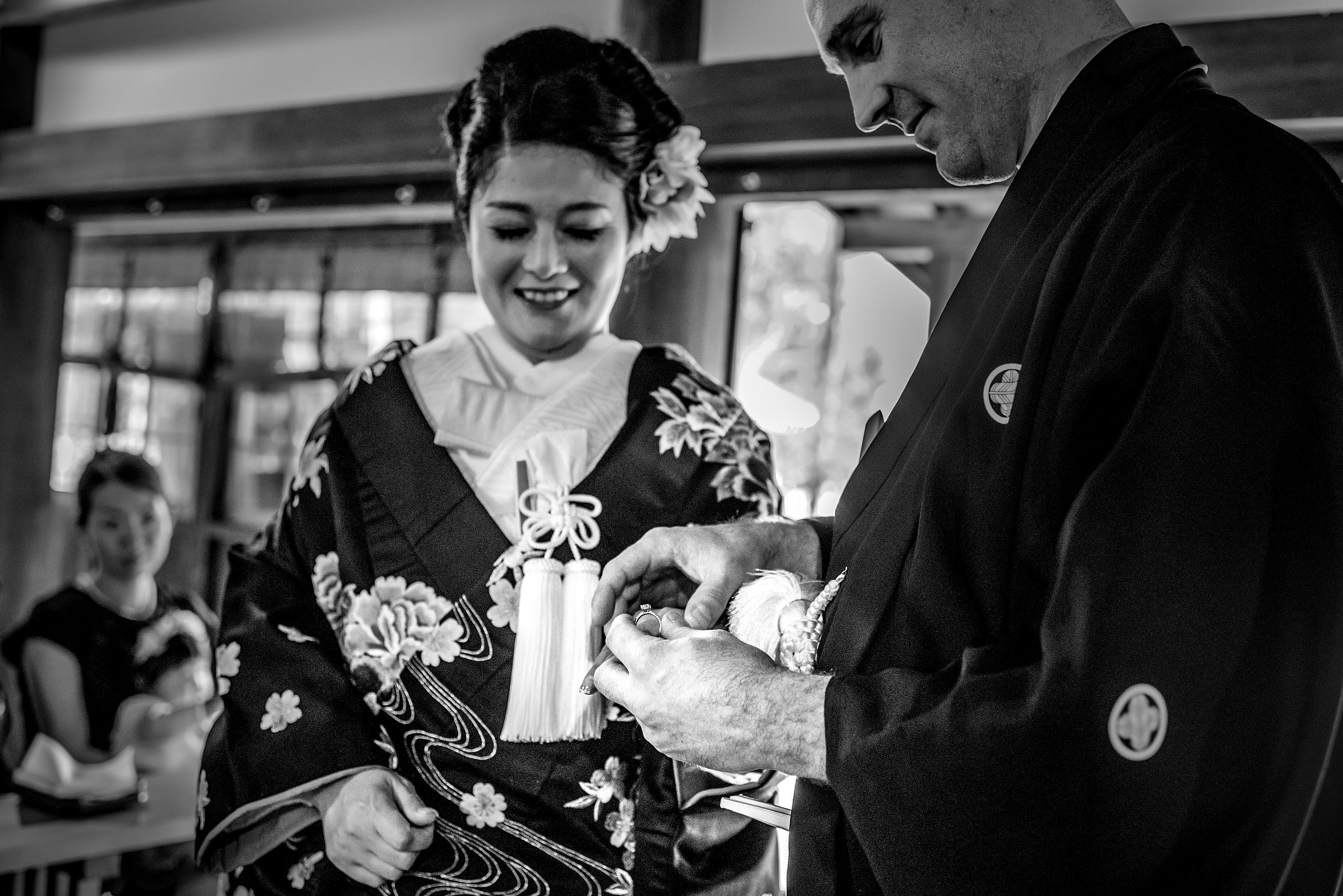 a Japanese bride and groom opening a gift by Japan Destination Wedding Photographer Sean LeBlanc