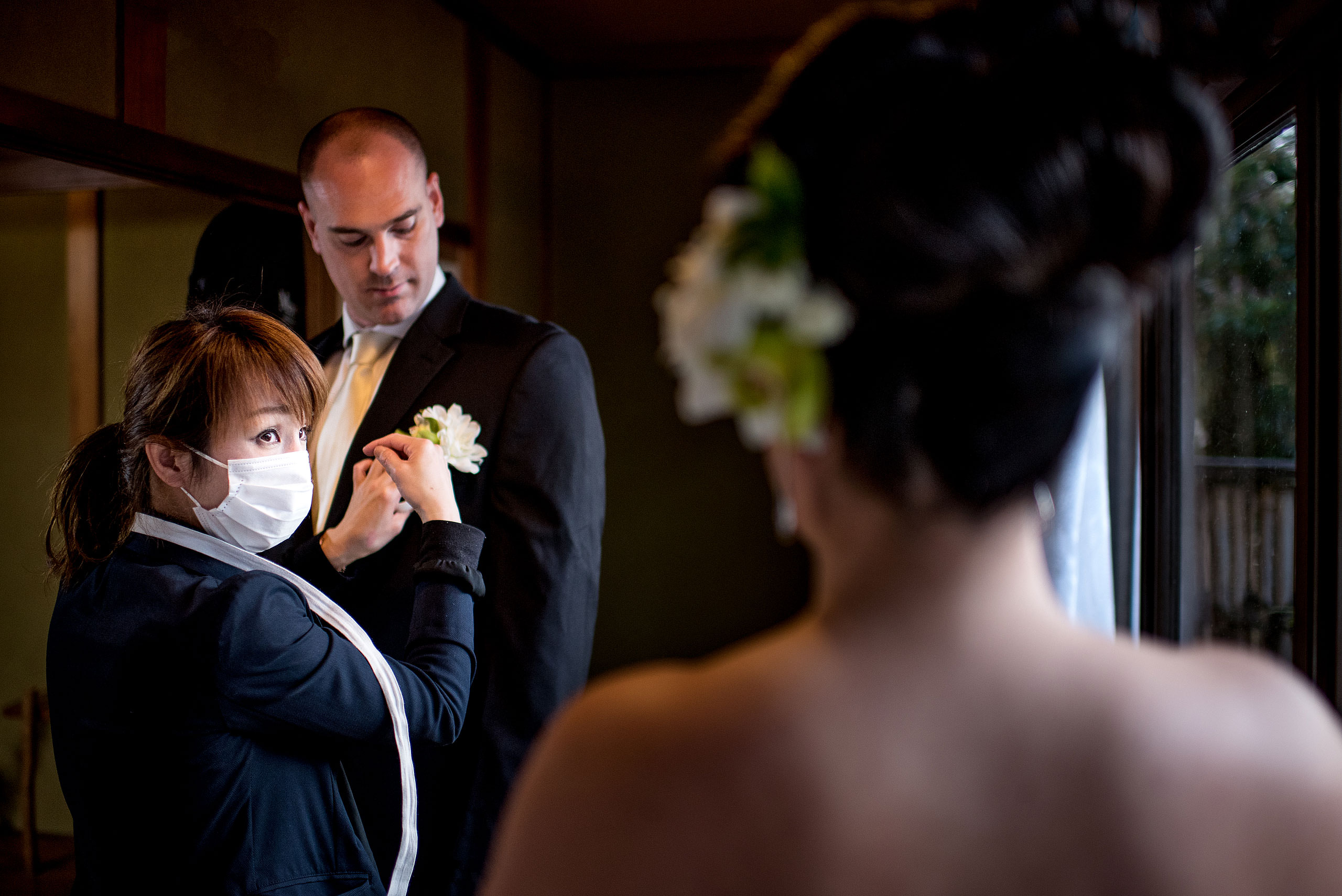 a groom getting ready for a reception by Japan Destination Wedding Photographer Sean LeBlanc