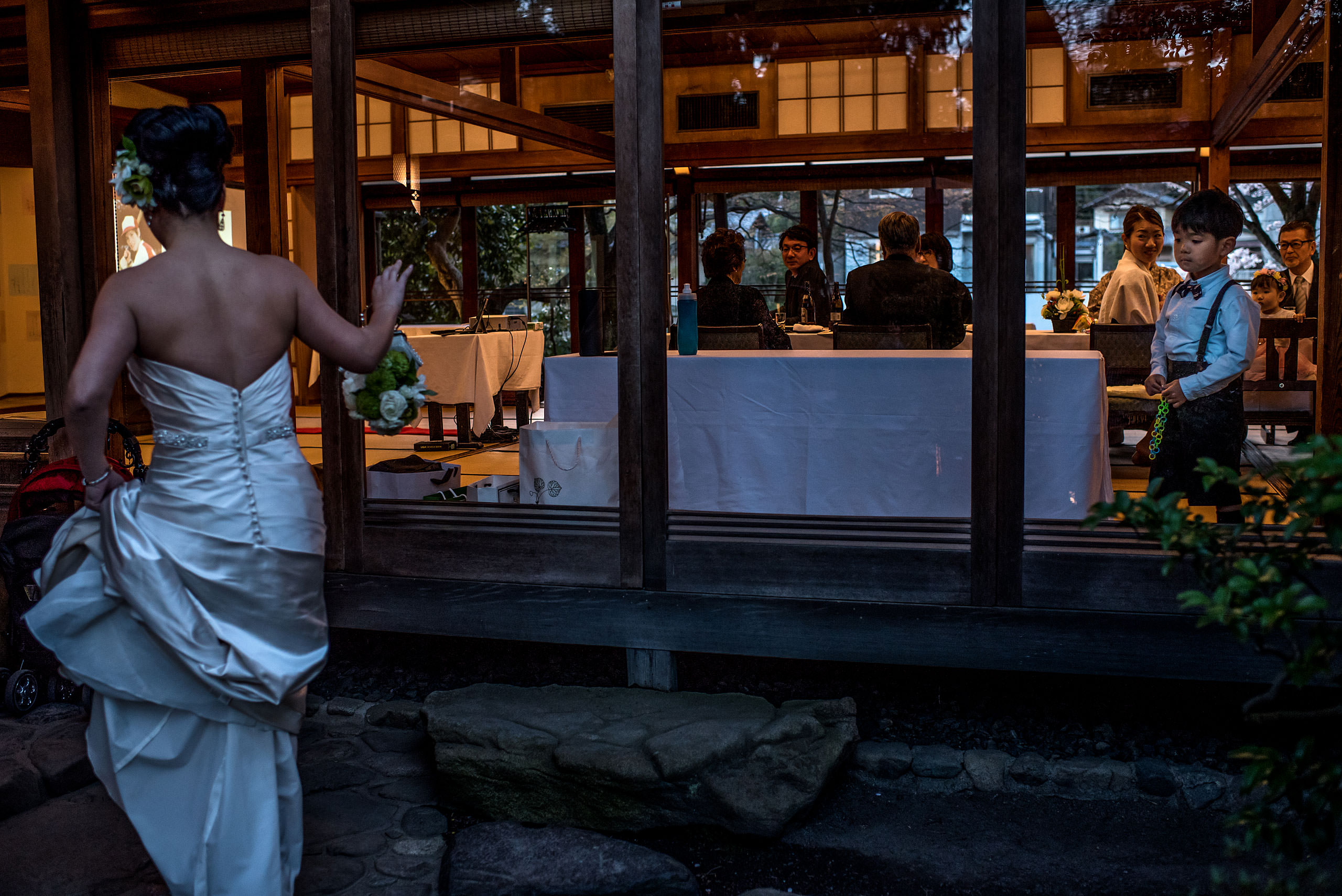 a bride walking into a wedding reception by Japan Destination Wedding Photographer Sean LeBlanc