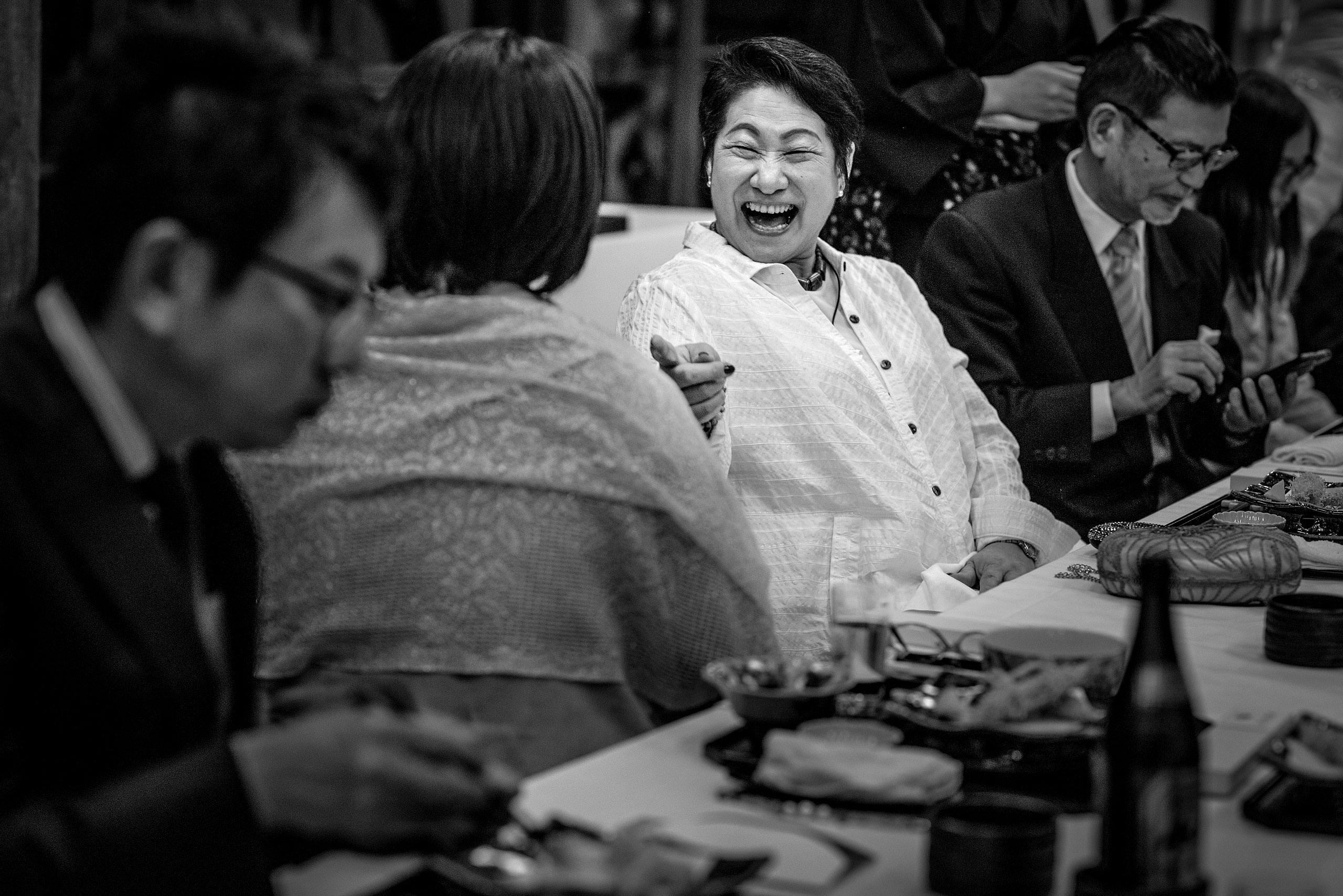 a wedding guest laughing by Japan Destination Wedding Photographer Sean LeBlanc