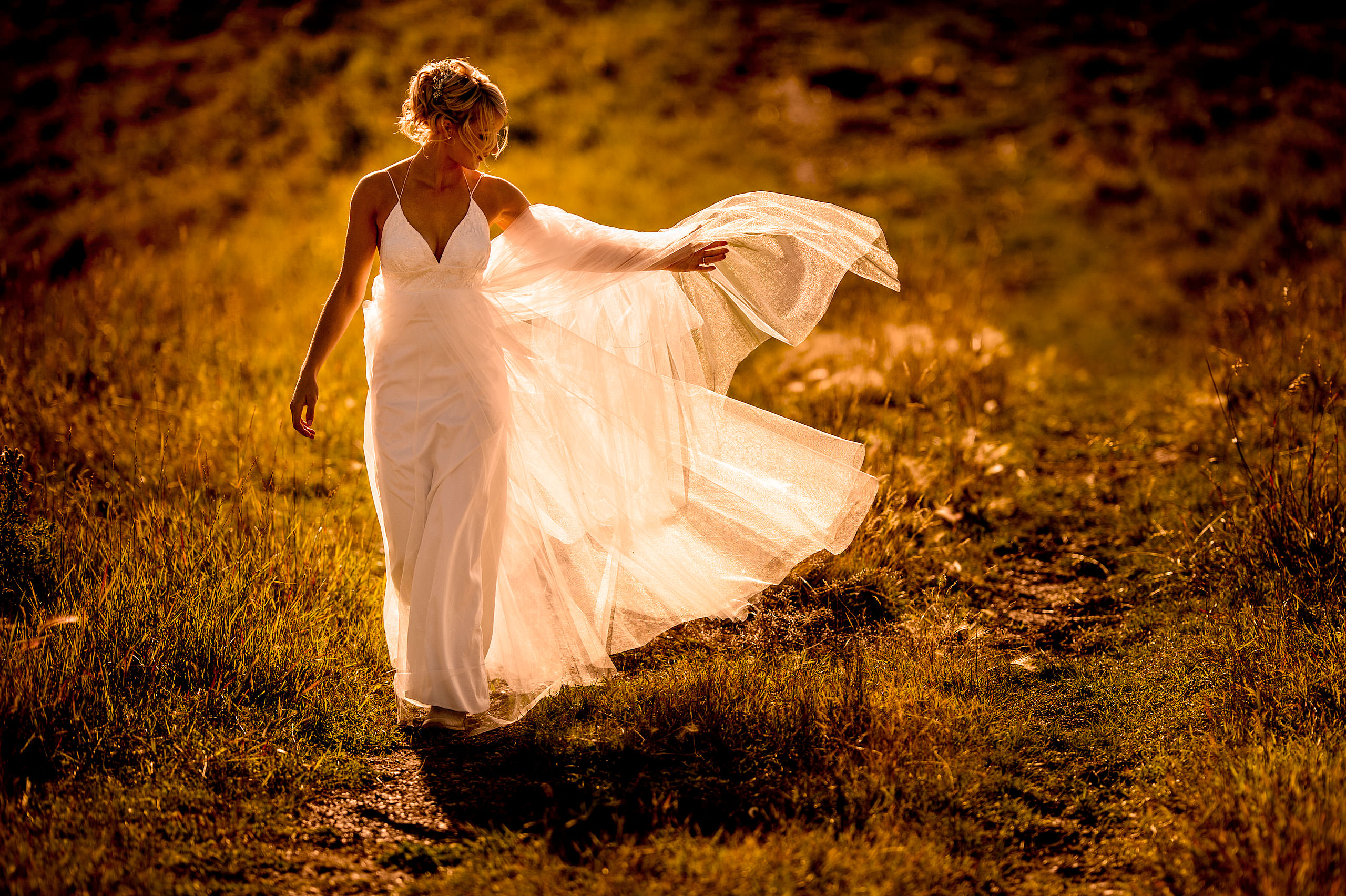 bride flipping her dress by top calgary wedding photographer sean leblanc