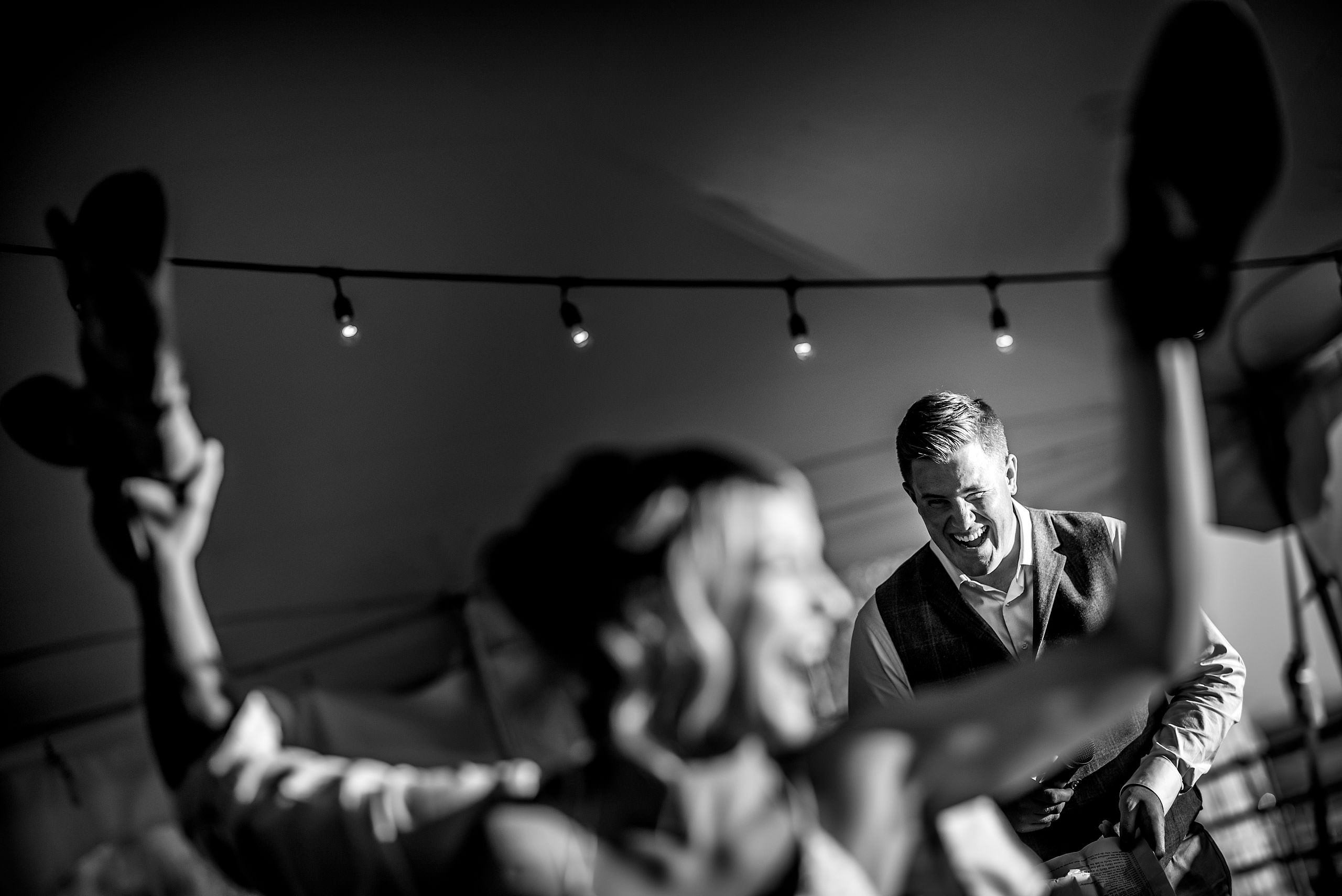 the best man at a wedding reception laughing at Cochrane Country Wedding by Sean LeBlanc