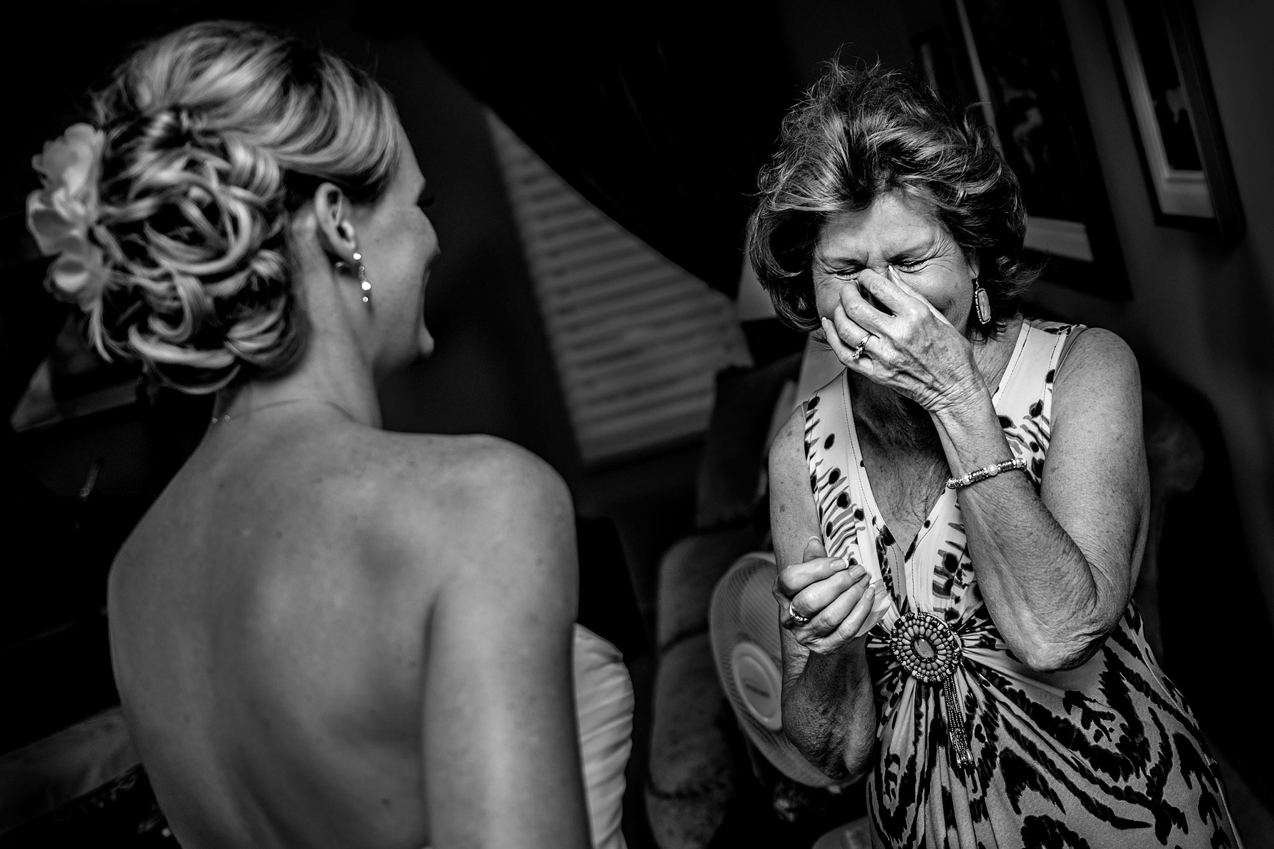 a bride's mom seeing her daughter for the first time on her wedding day by calgary wedding photographers