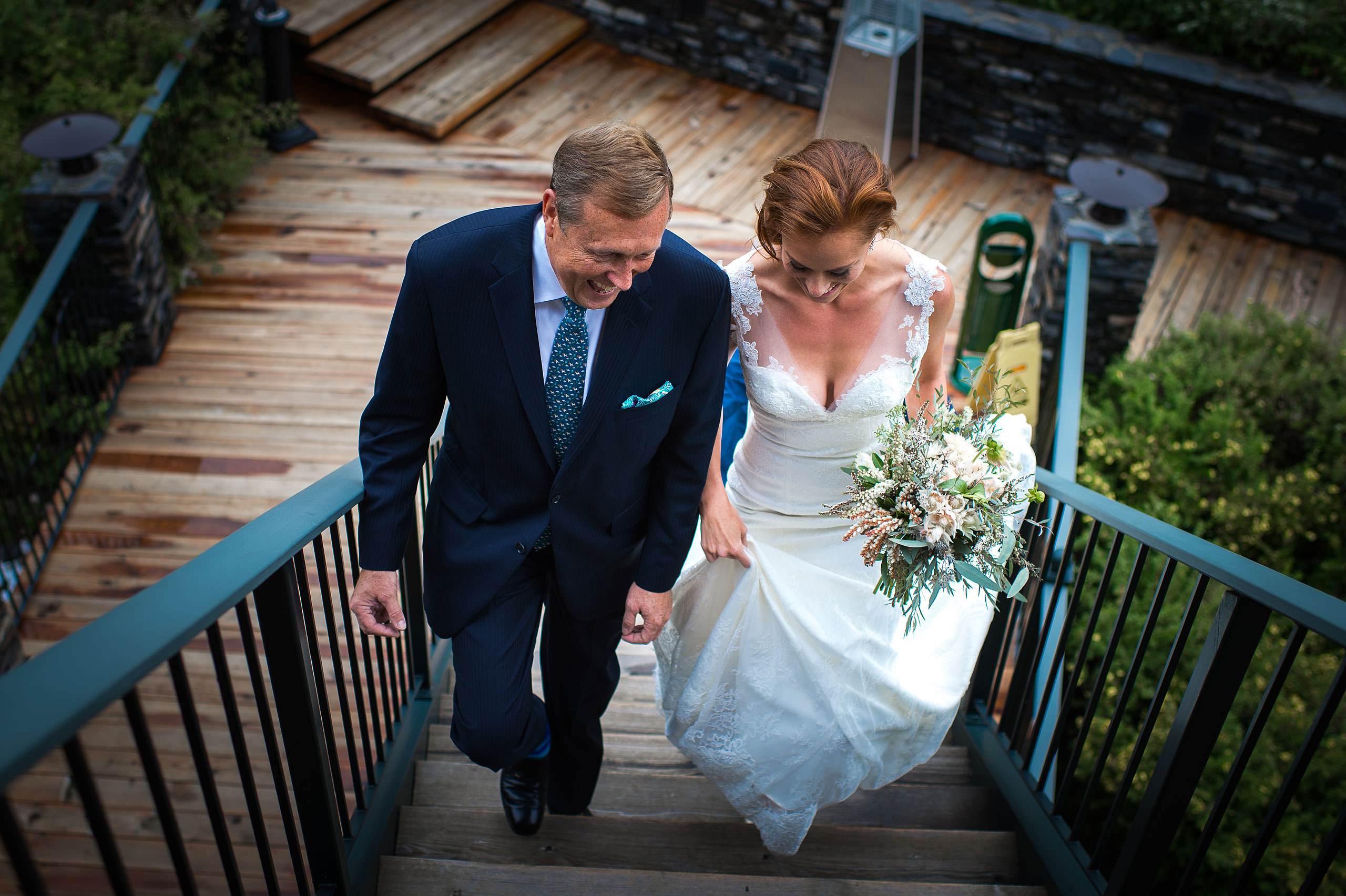 bride walking with dad up the stairs at Priddis Azuridge Wedding by sean leblanc