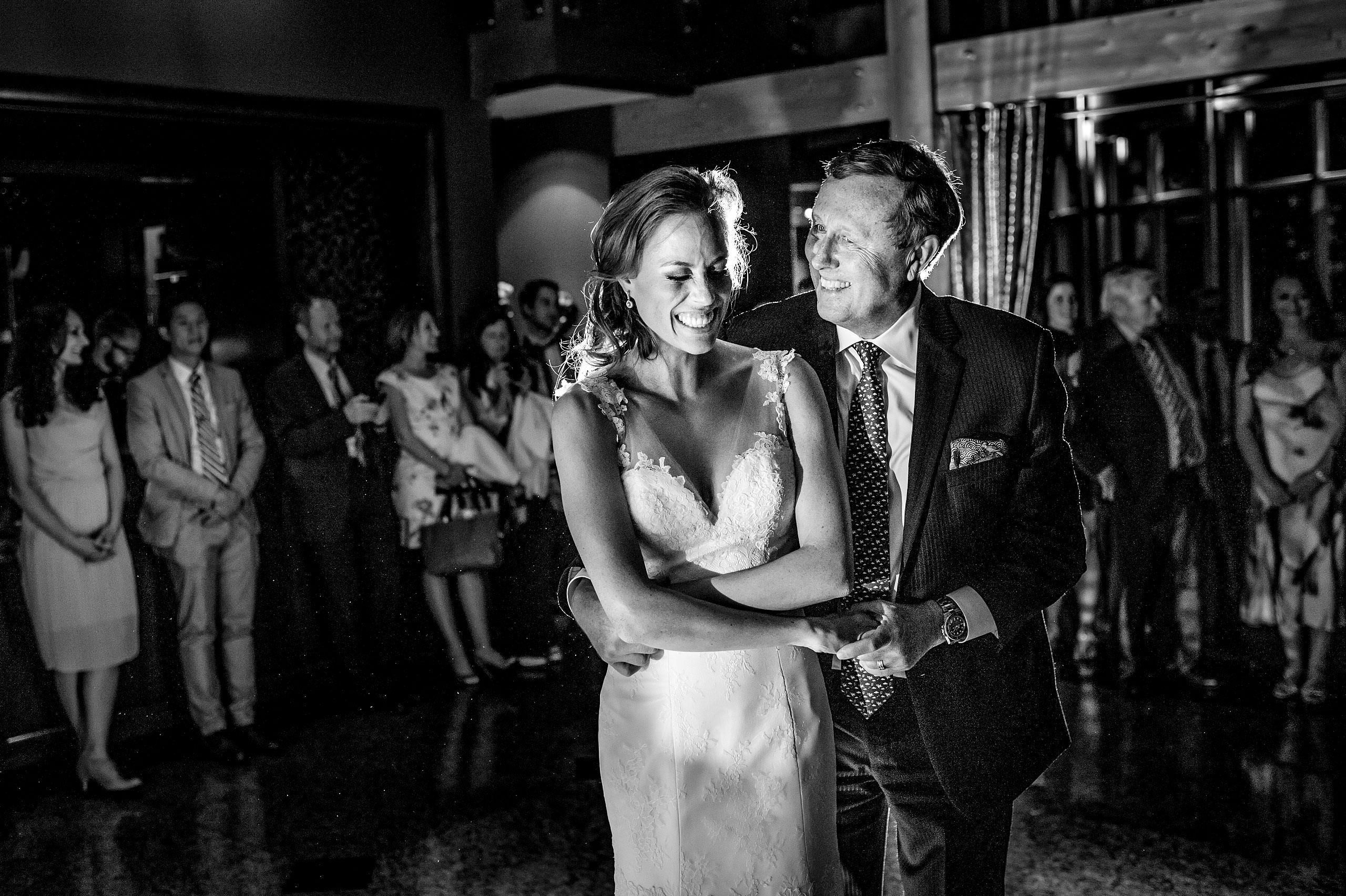 bride dancing with her dad at her wedding reception at Priddis Azuridge Wedding by sean leblanc