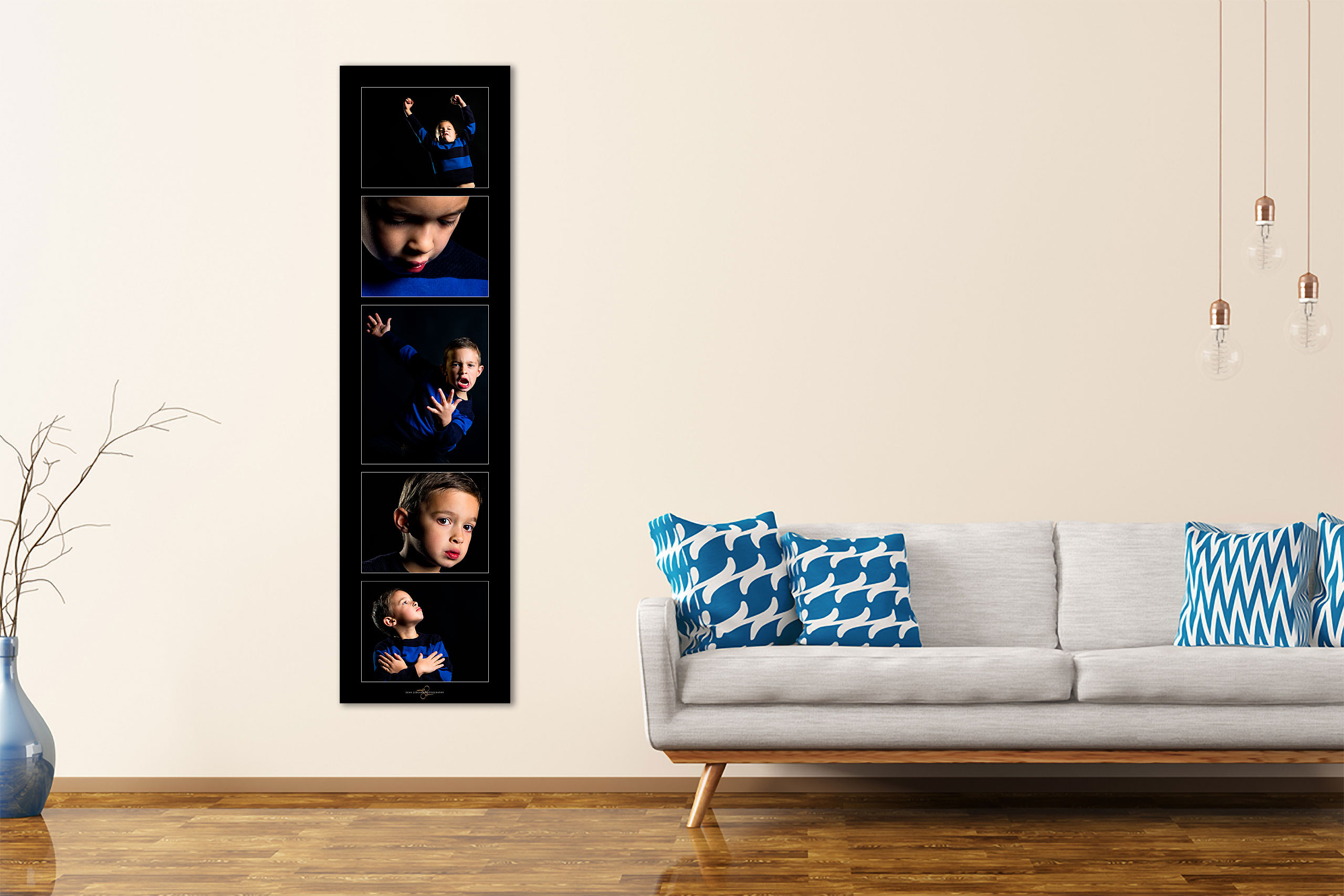 large wall art collection of a boy hung beside a couch by top calgary portrait photographer sean leblanc