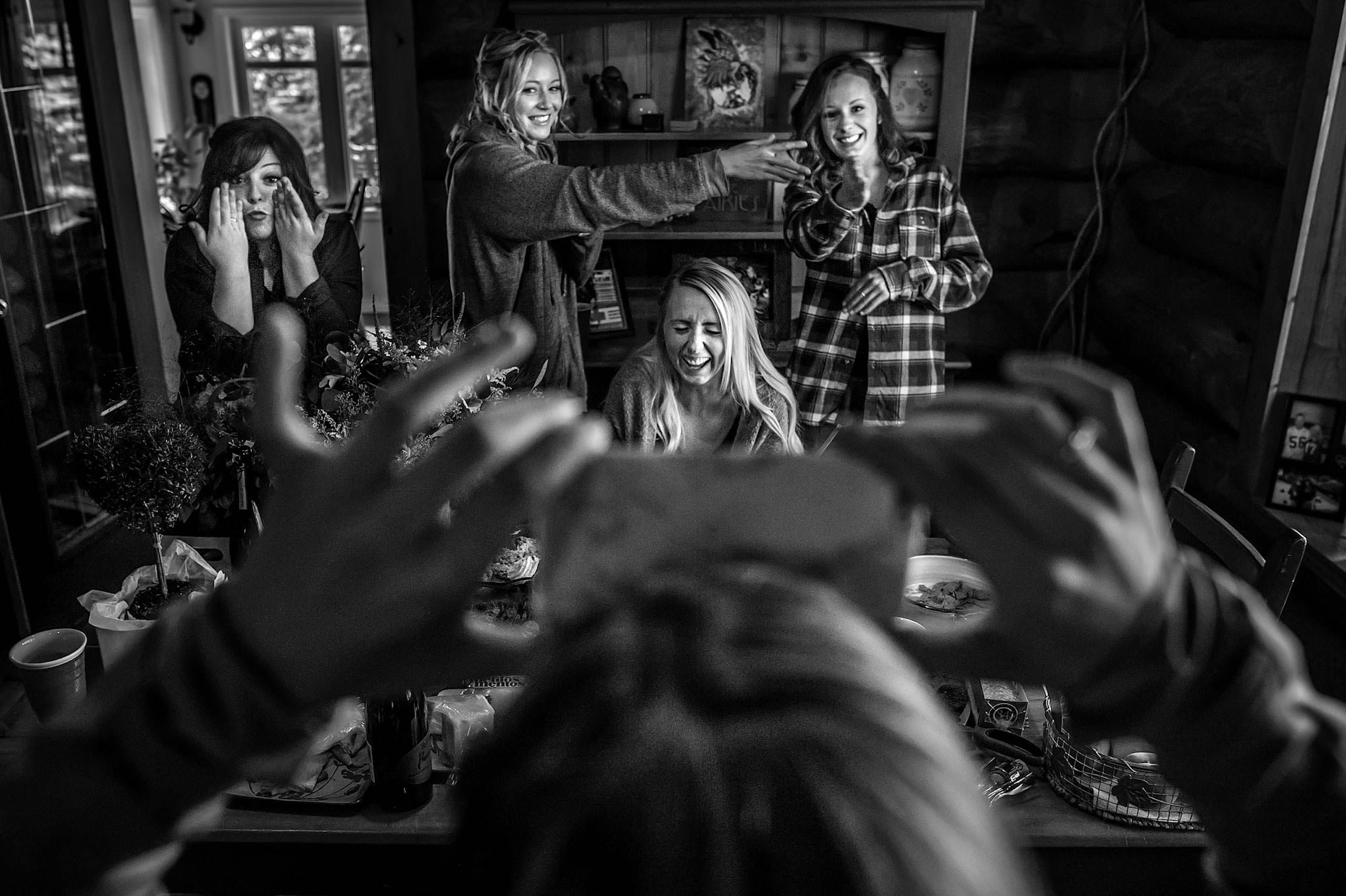 bridesmaids playing a game by calgary wedding photographers