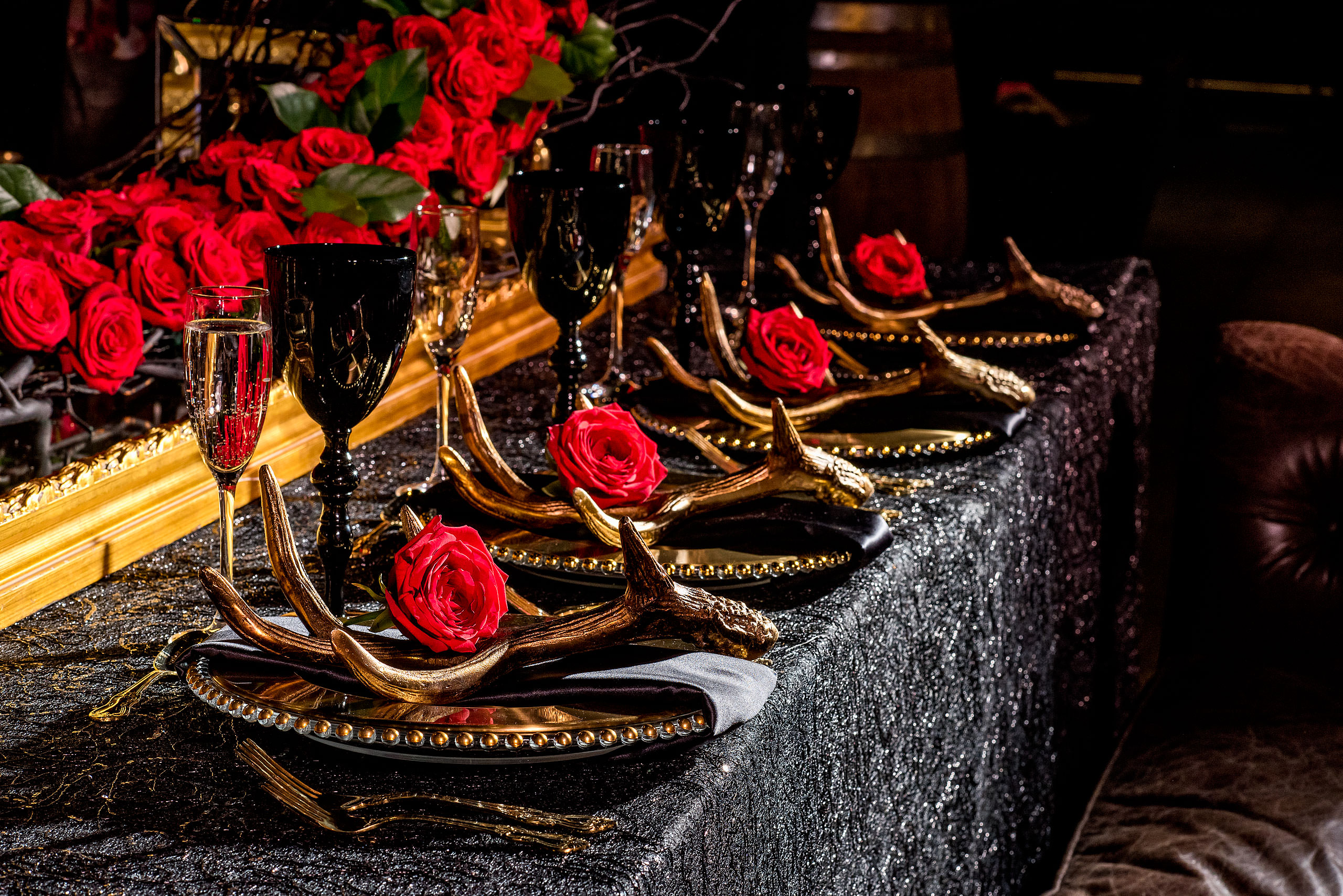 a row of plates with roses beside them by calgary confetti fashion photographer sean leblanc