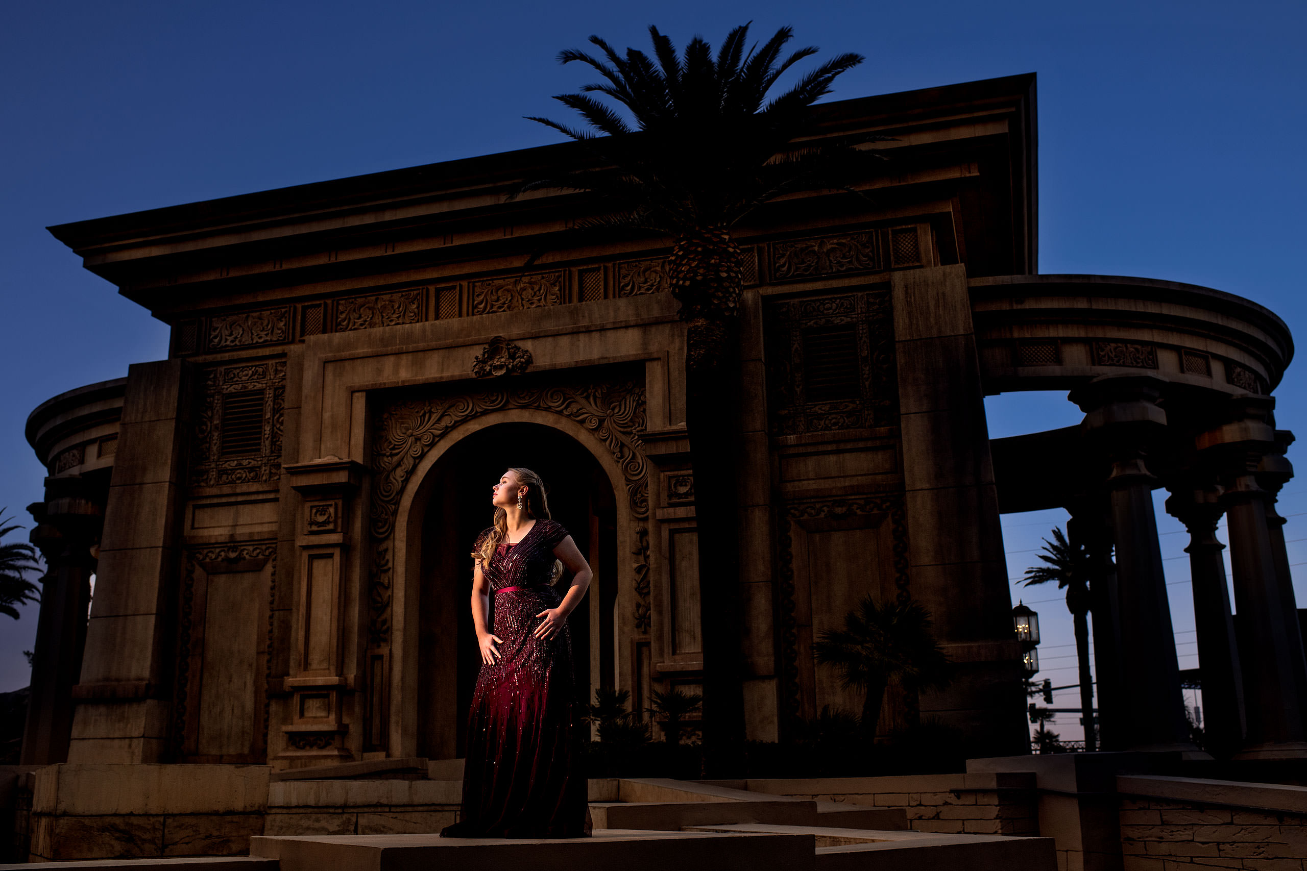 model woman wearing a red dress standing in front of the Mandalay Bay hotel in Las Vegas - sean leblanc photography mentorship
