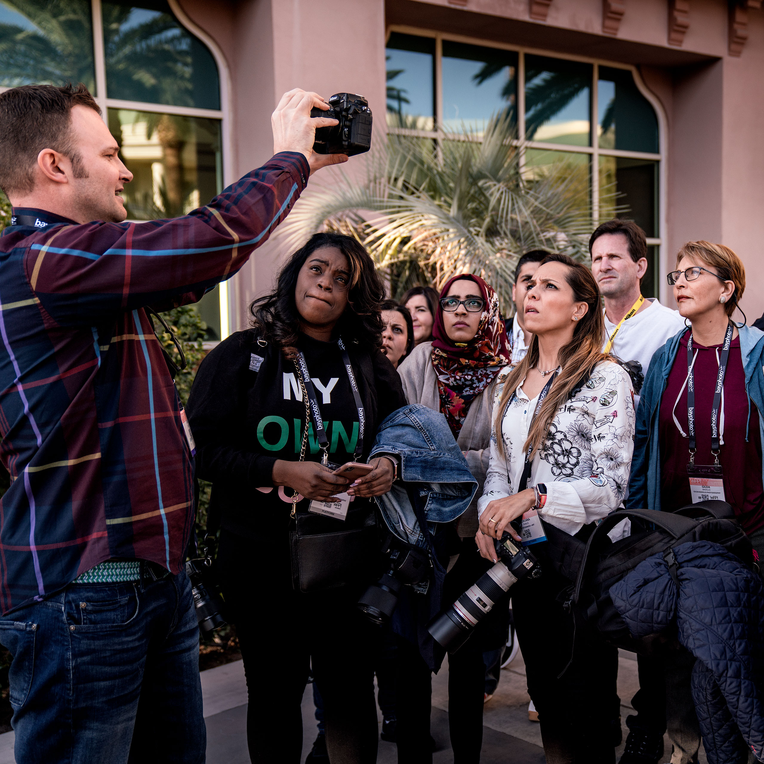 a group of photography students on a photowalk at WPPI learning about off camera flash - sean leblanc photography mentorship