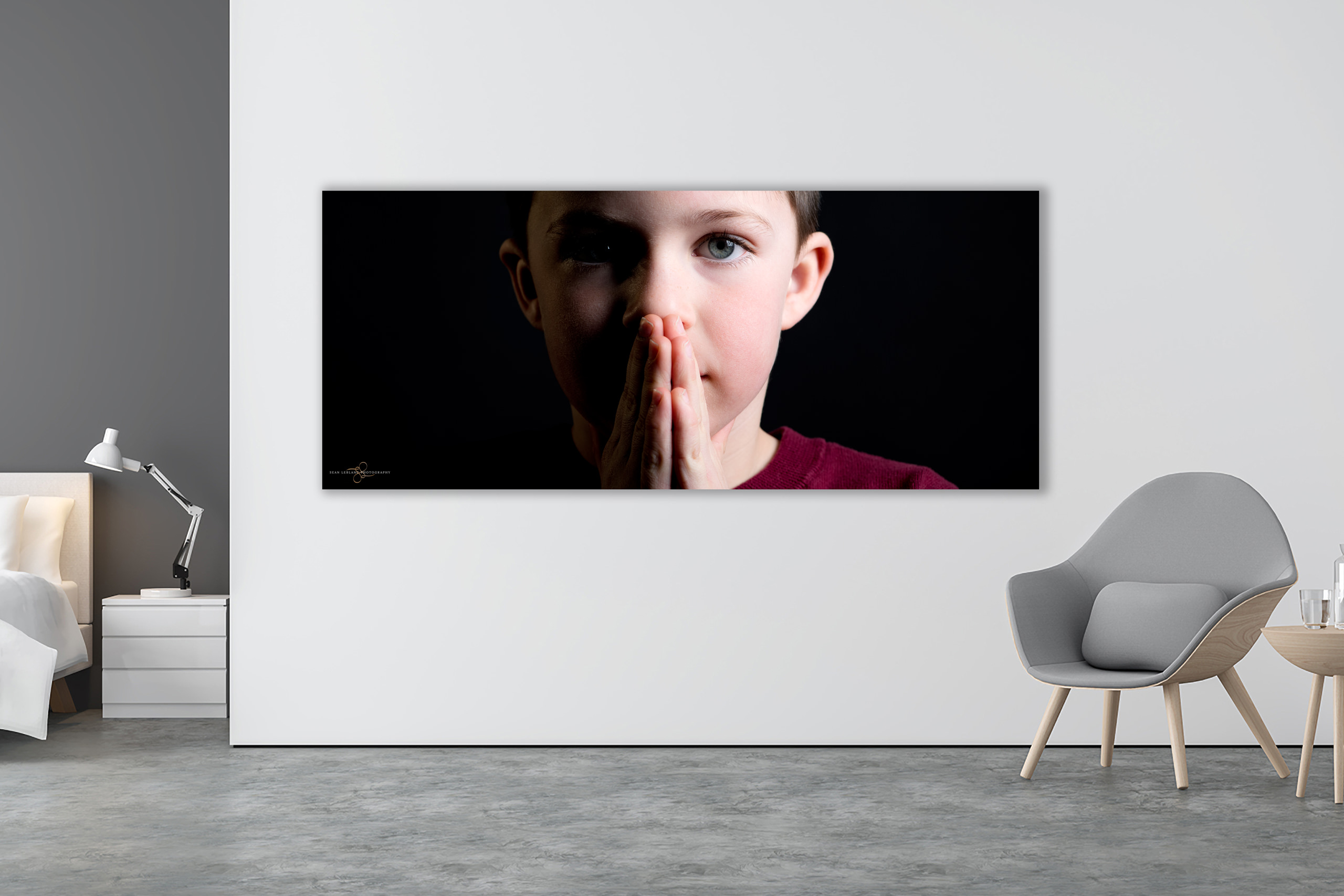 panoramic wall art of a young boy in a studio on the wall of a modern room by calgary portrait photographer sean leblanc