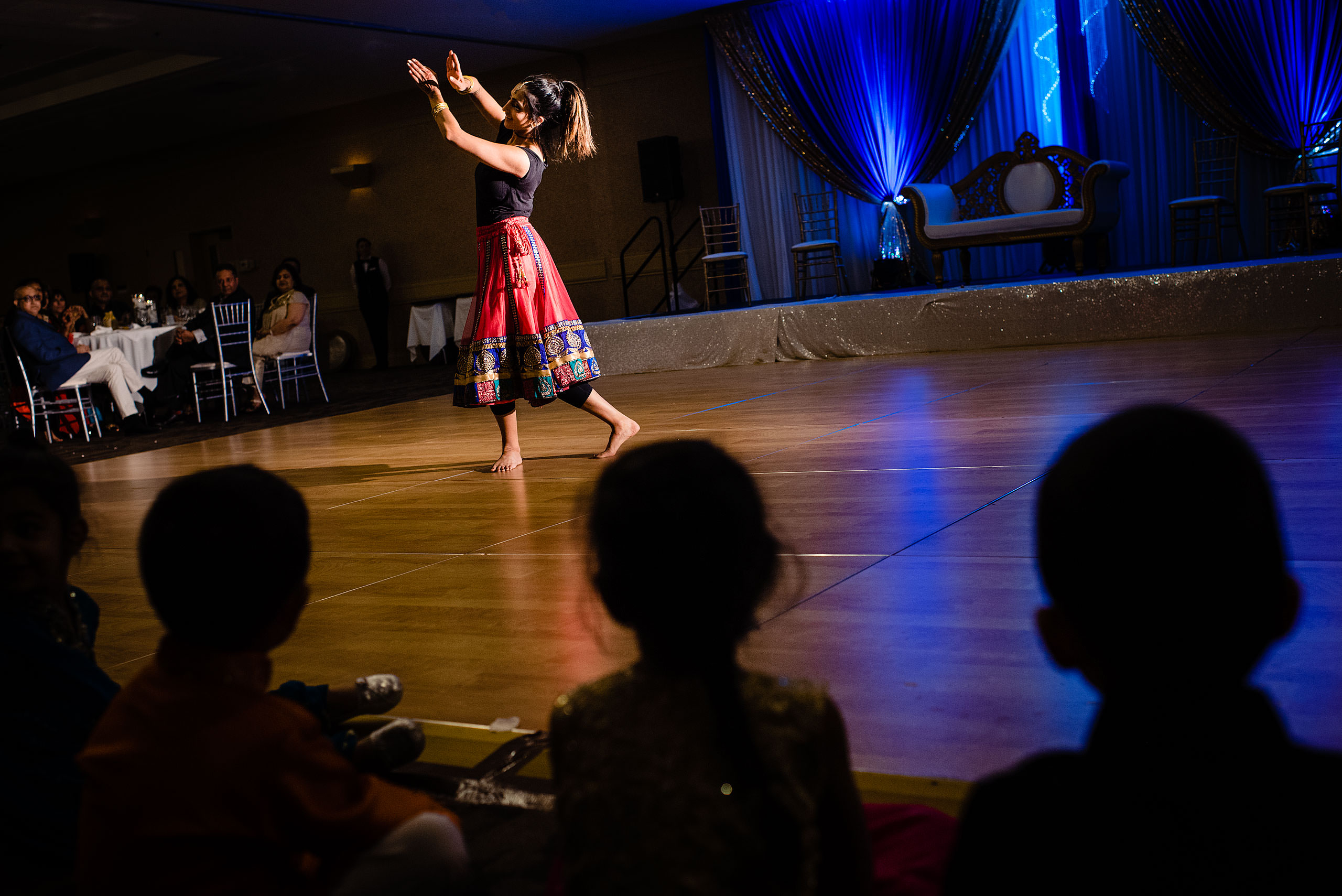 an indian dancer performing at a wedding by Calgary Banff Wedding Photographer Sean LeBlanc
