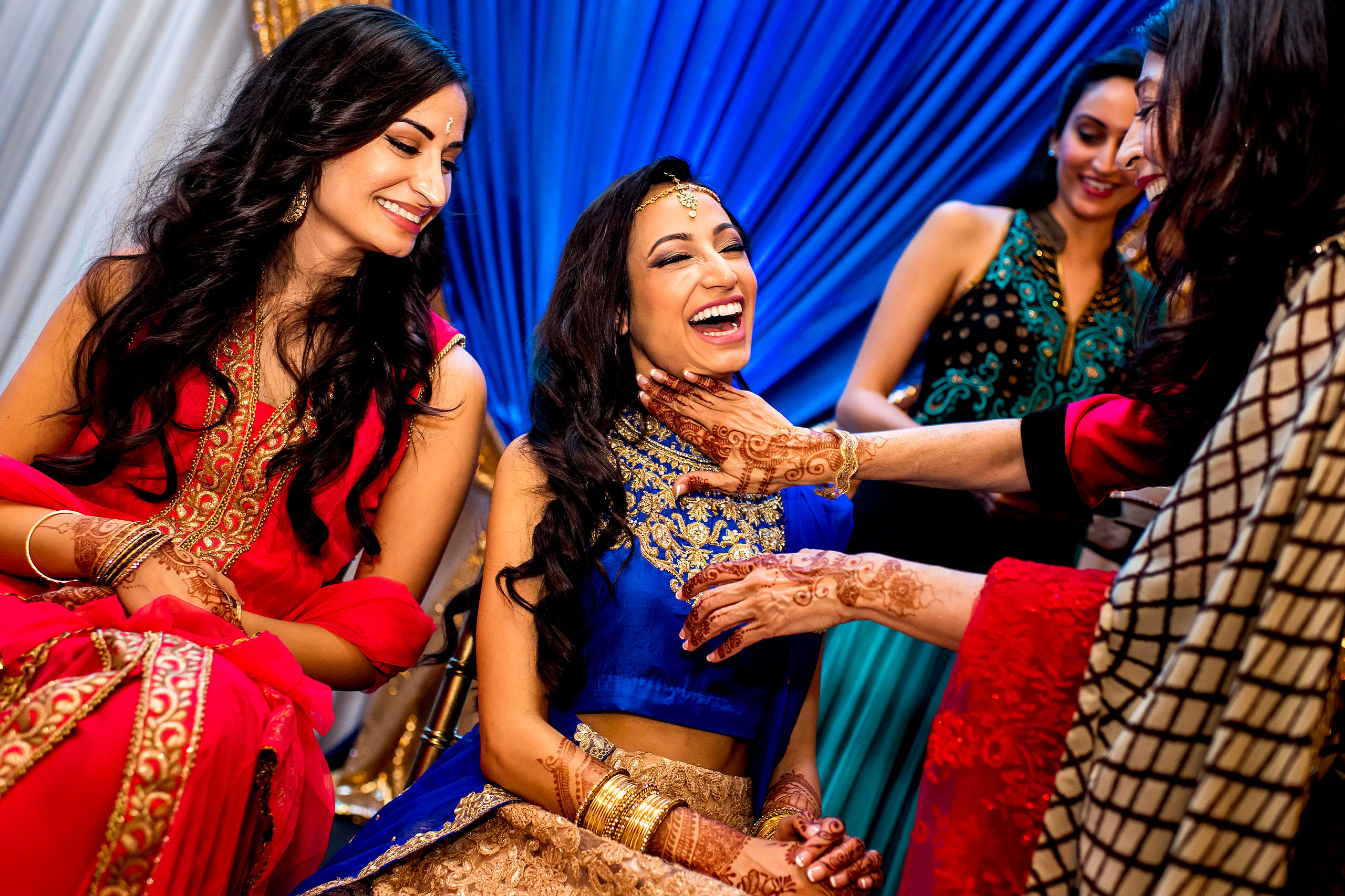 an indian bride laughing by Calgary Banff Wedding Photographer Sean LeBlanc