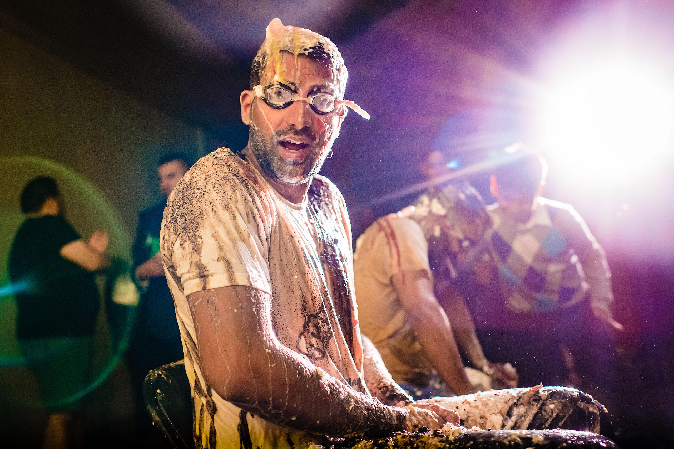 an Indian man wearing goggles by Calgary Banff Wedding Photographer Sean LeBlanc