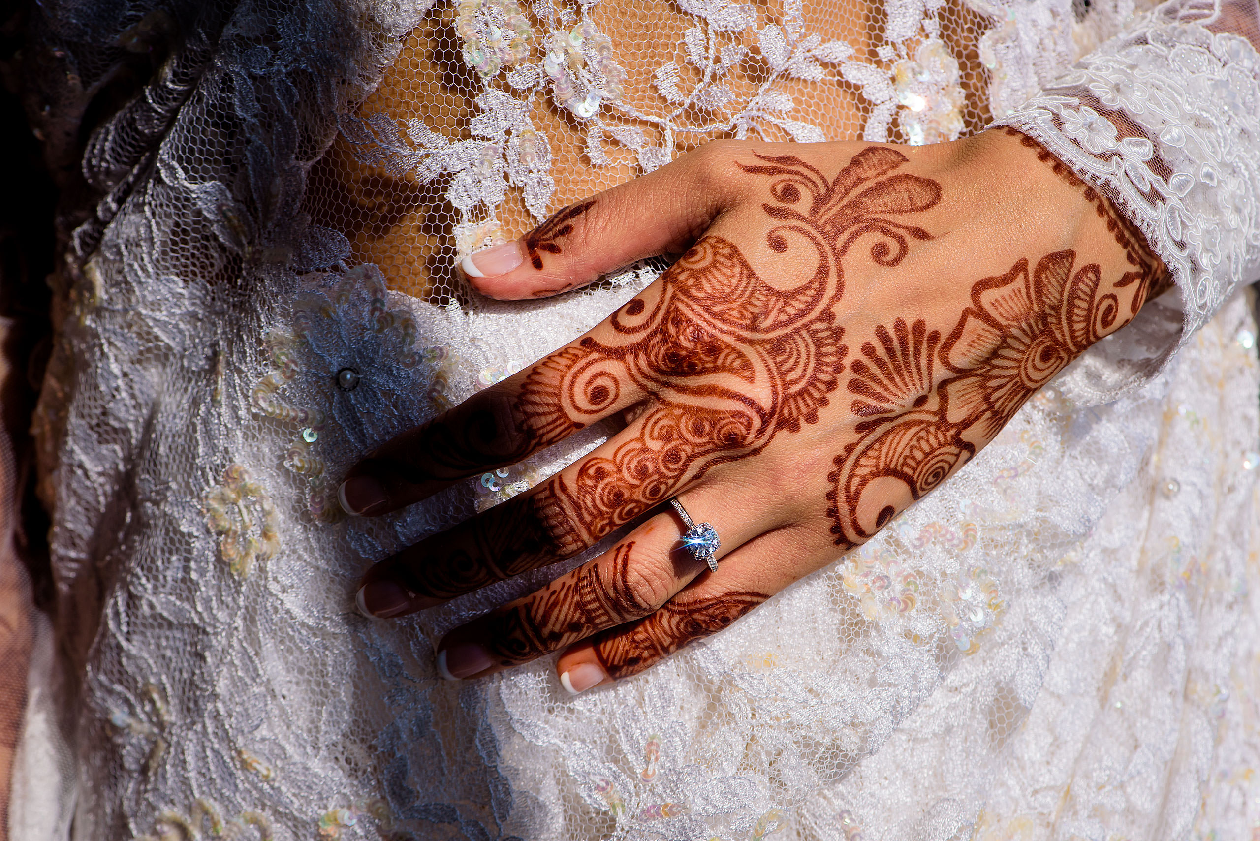 a close up photo on an Indian bride's wedding ring by Calgary Banff Wedding Photographer Sean LeBlanc