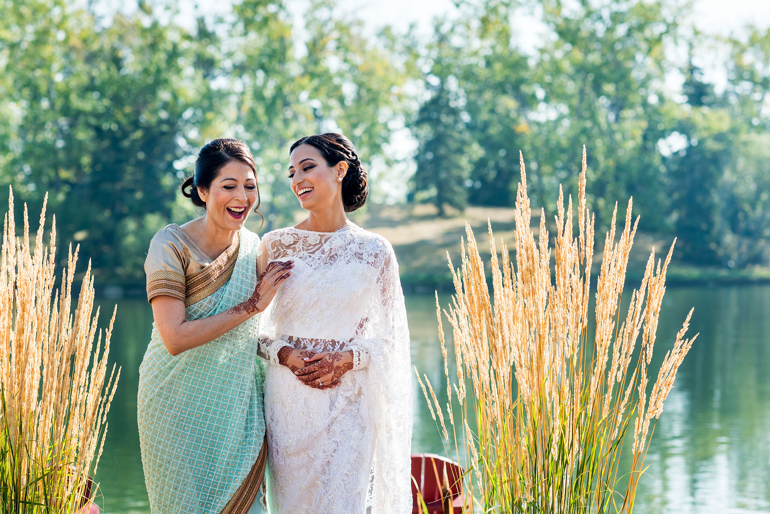 a mom and daughter laughing together by Calgary Banff Wedding Photographer Sean LeBlanc