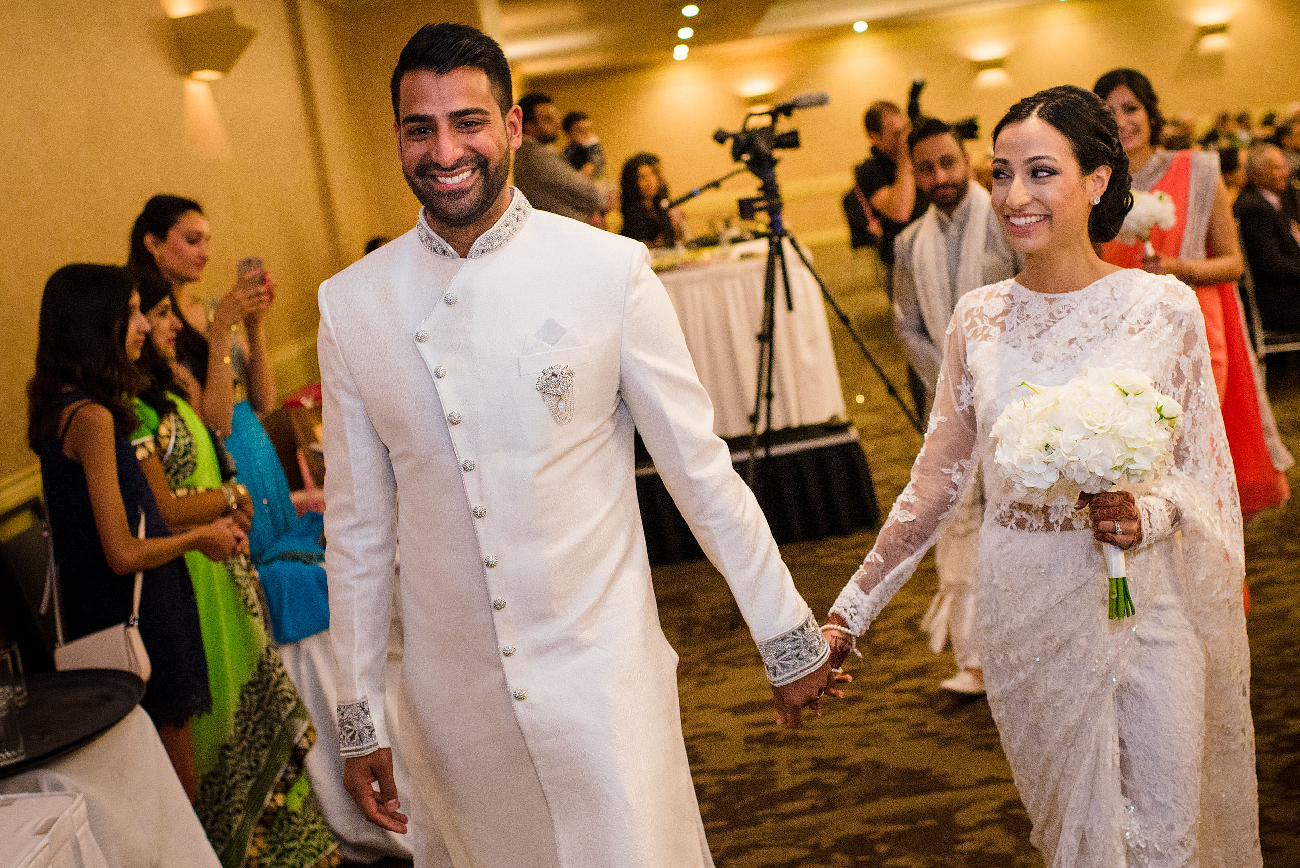 an Indian bride and groom walking away from their wedding ceremony by Calgary Banff Wedding Photographer Sean LeBlanc