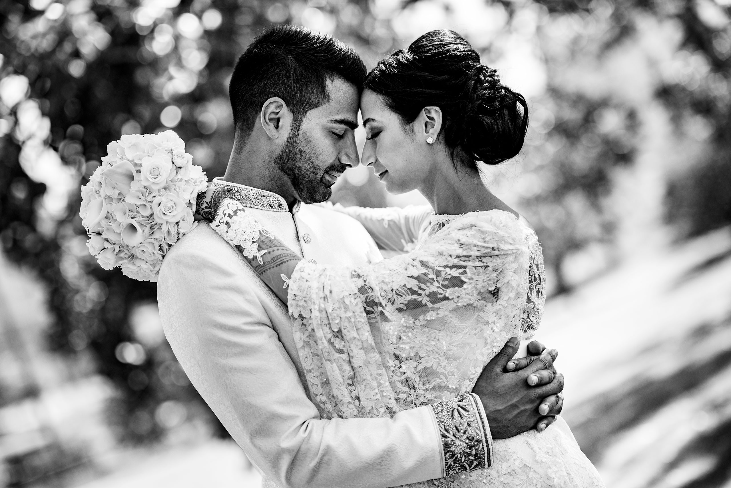 a bride and groom embracing by Calgary Banff Wedding Photographer Sean LeBlanc