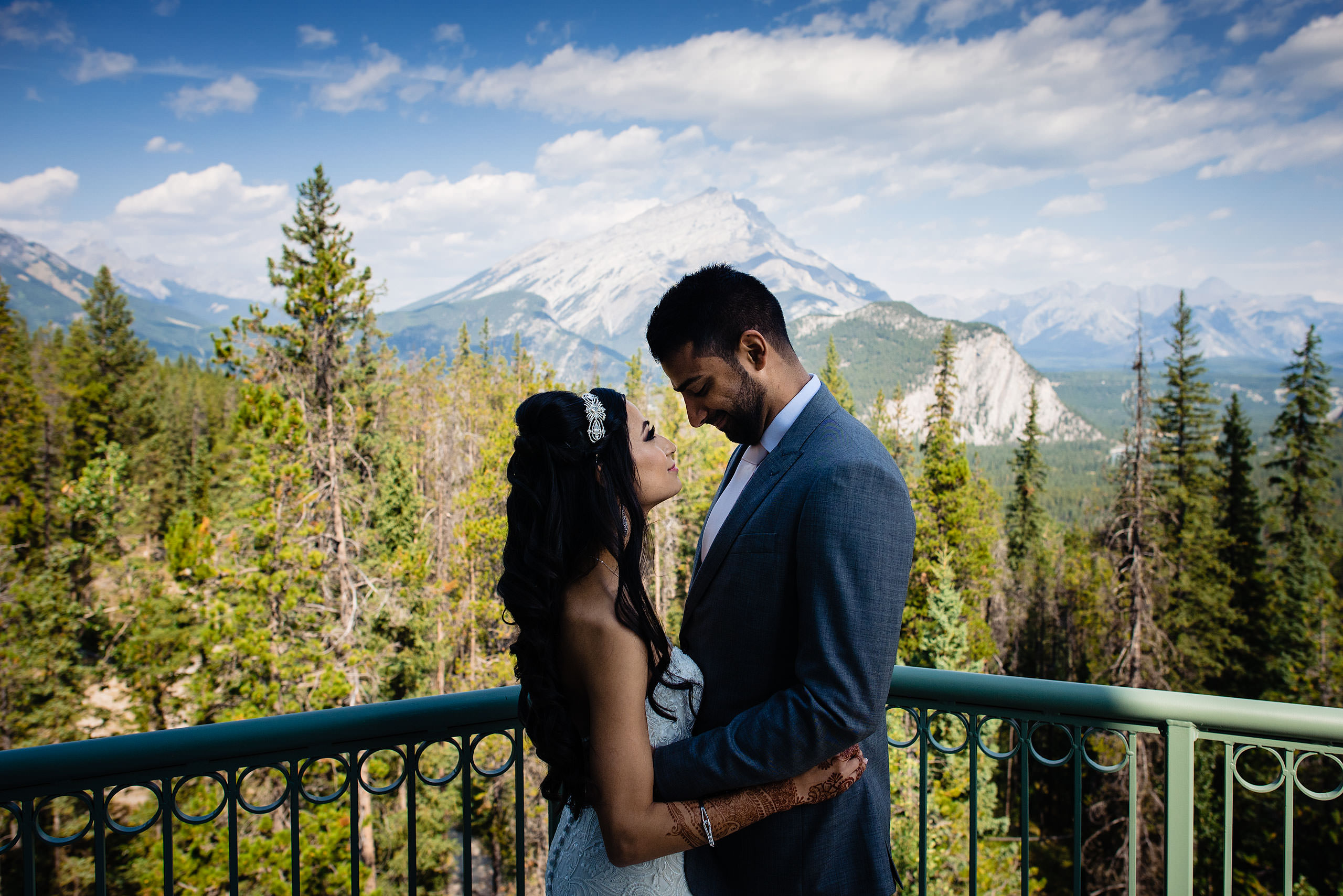 a bride and groom embracing at the Rimrock hotel by Calgary Banff Wedding Photographer Sean LeBlanc
