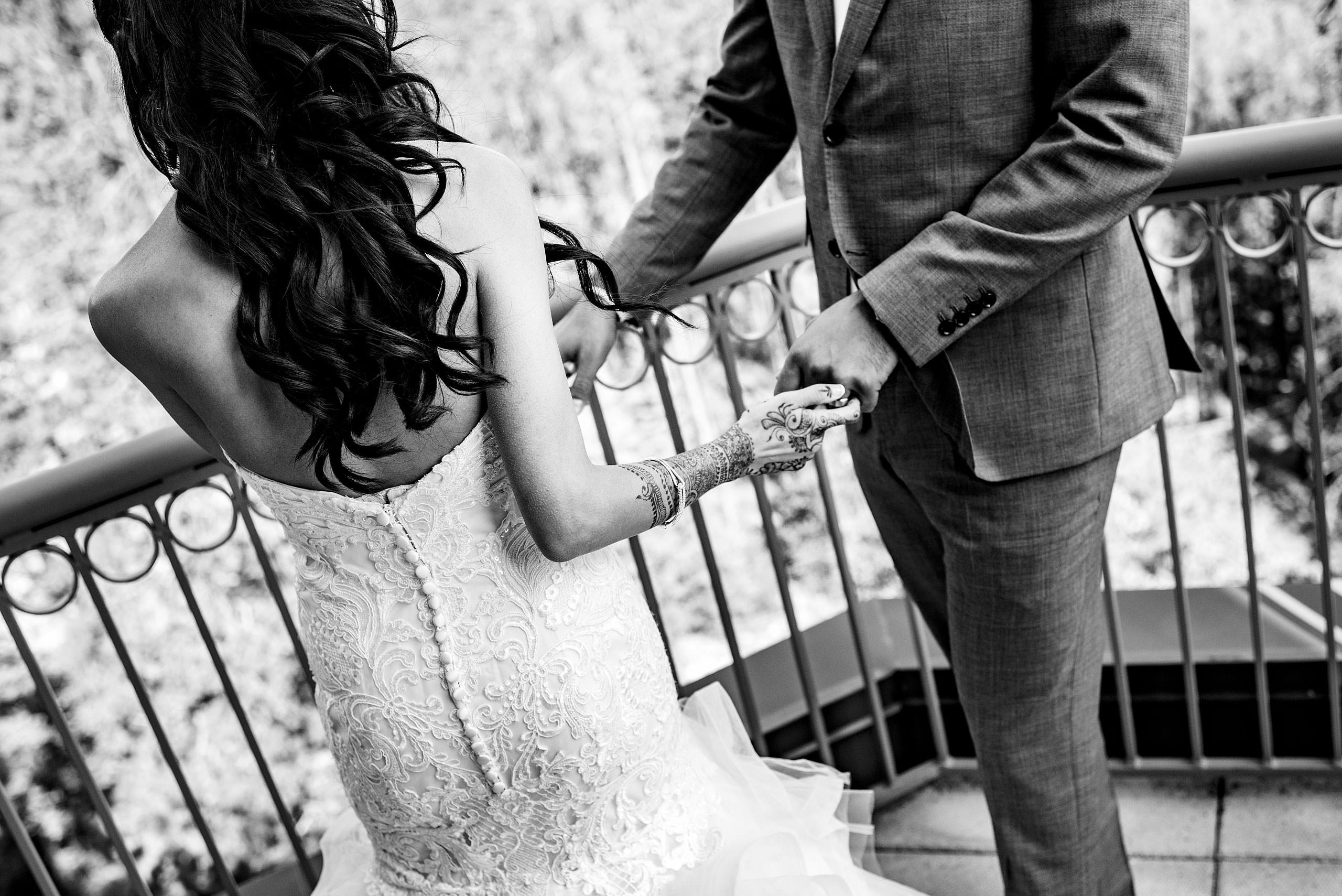 a bride turning away from her groom by Calgary Banff Wedding Photographer Sean LeBlanc