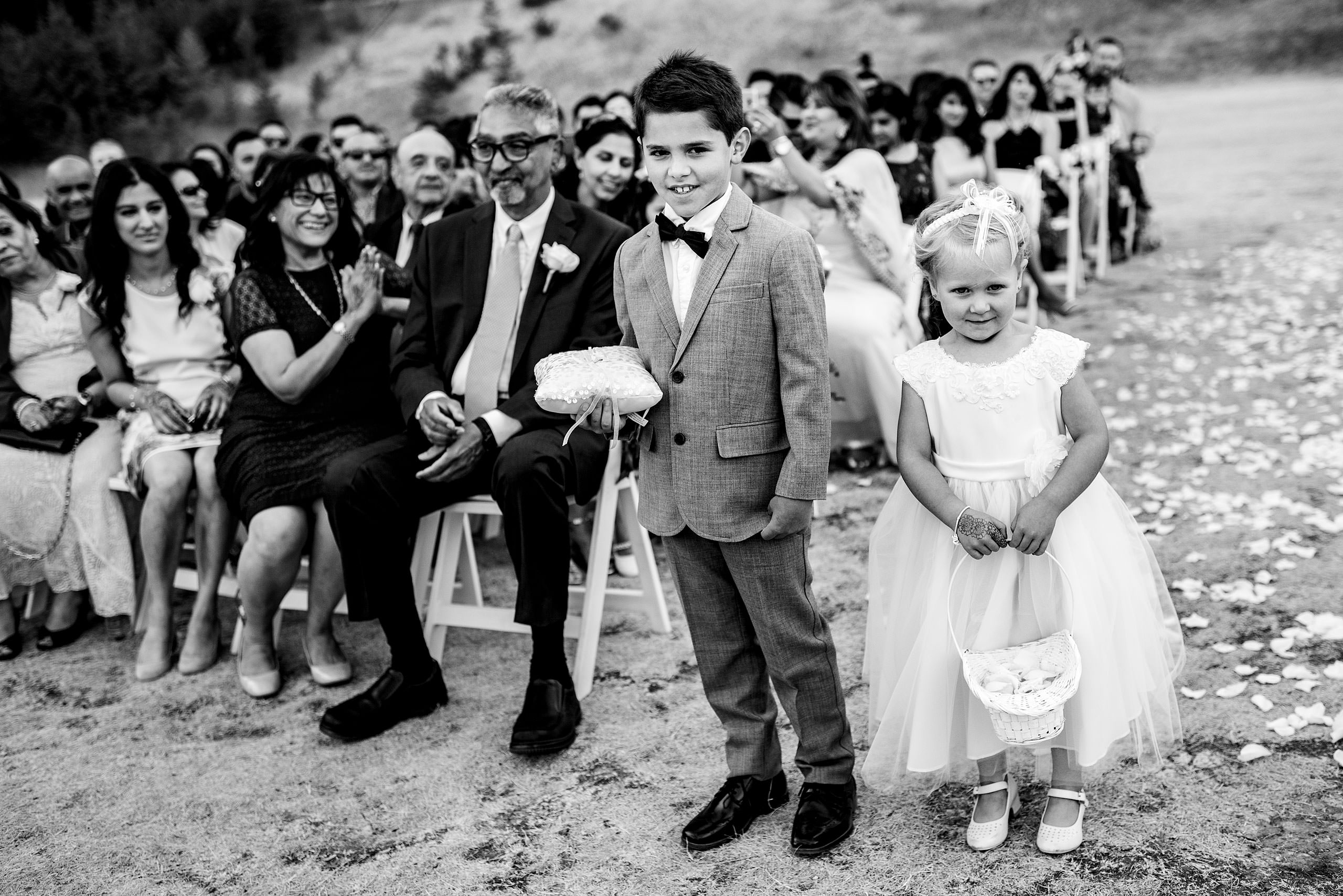 two young children standing at the from of a wedding ceremony by Calgary Banff Wedding Photographer Sean LeBlanc