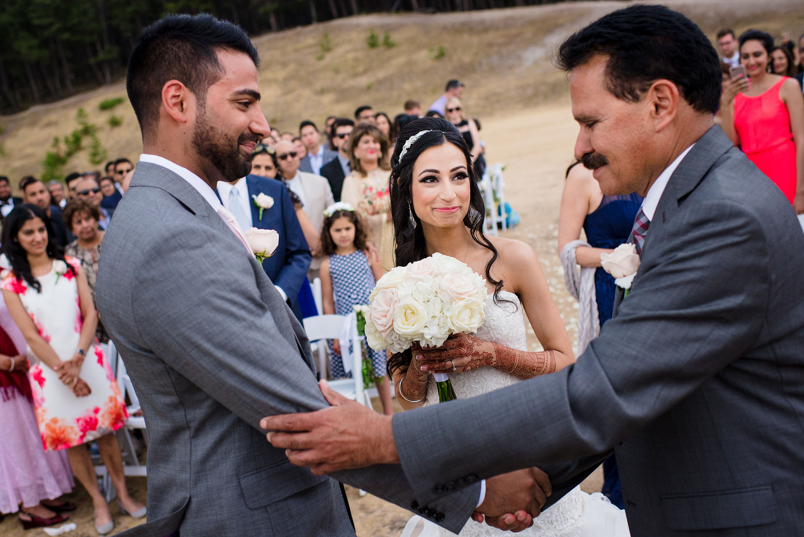 a bride's dad shaking the hand of a groom by Calgary Banff Wedding Photographer Sean LeBlanc