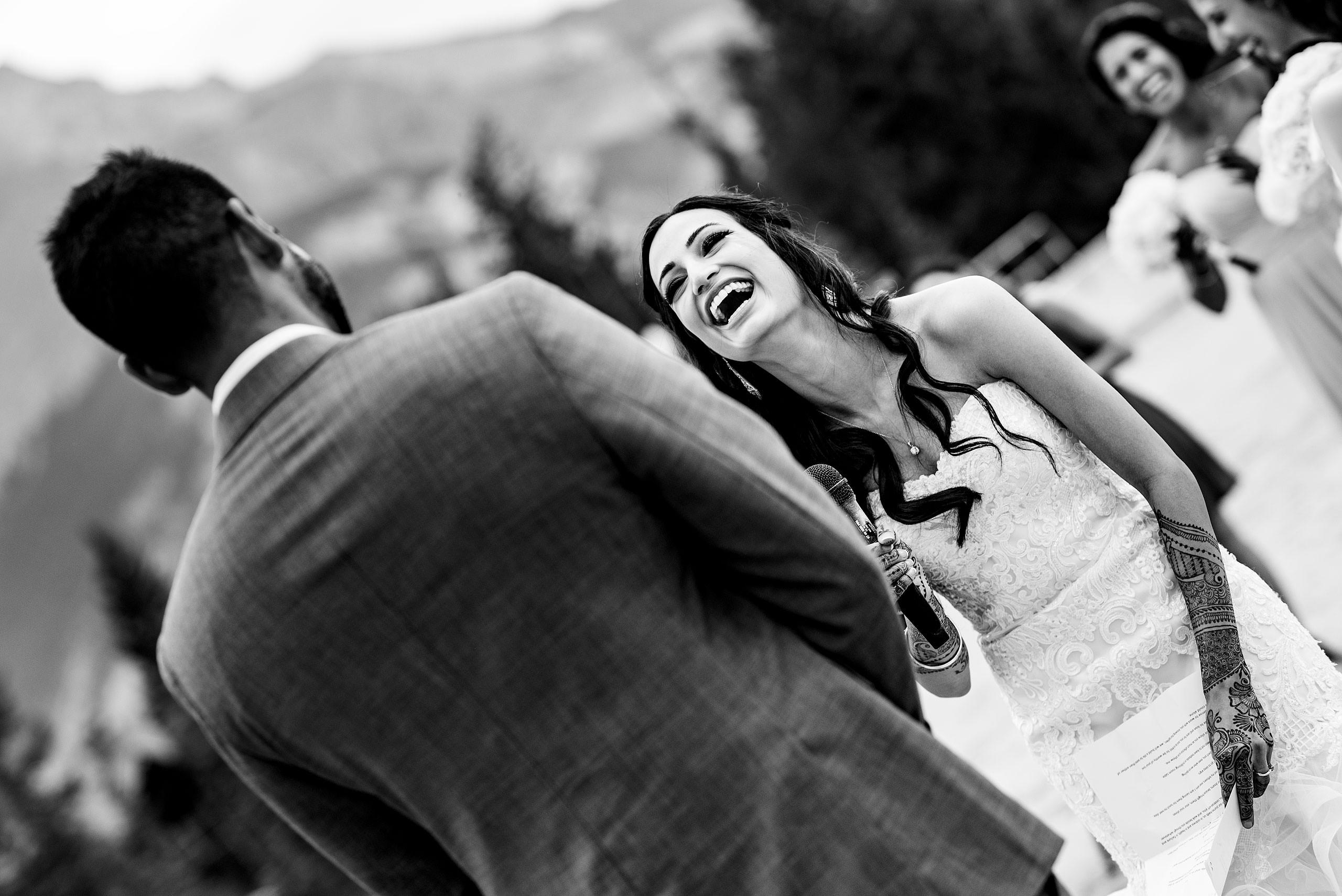 a bride laughing by Calgary Banff Wedding Photographer Sean LeBlanc