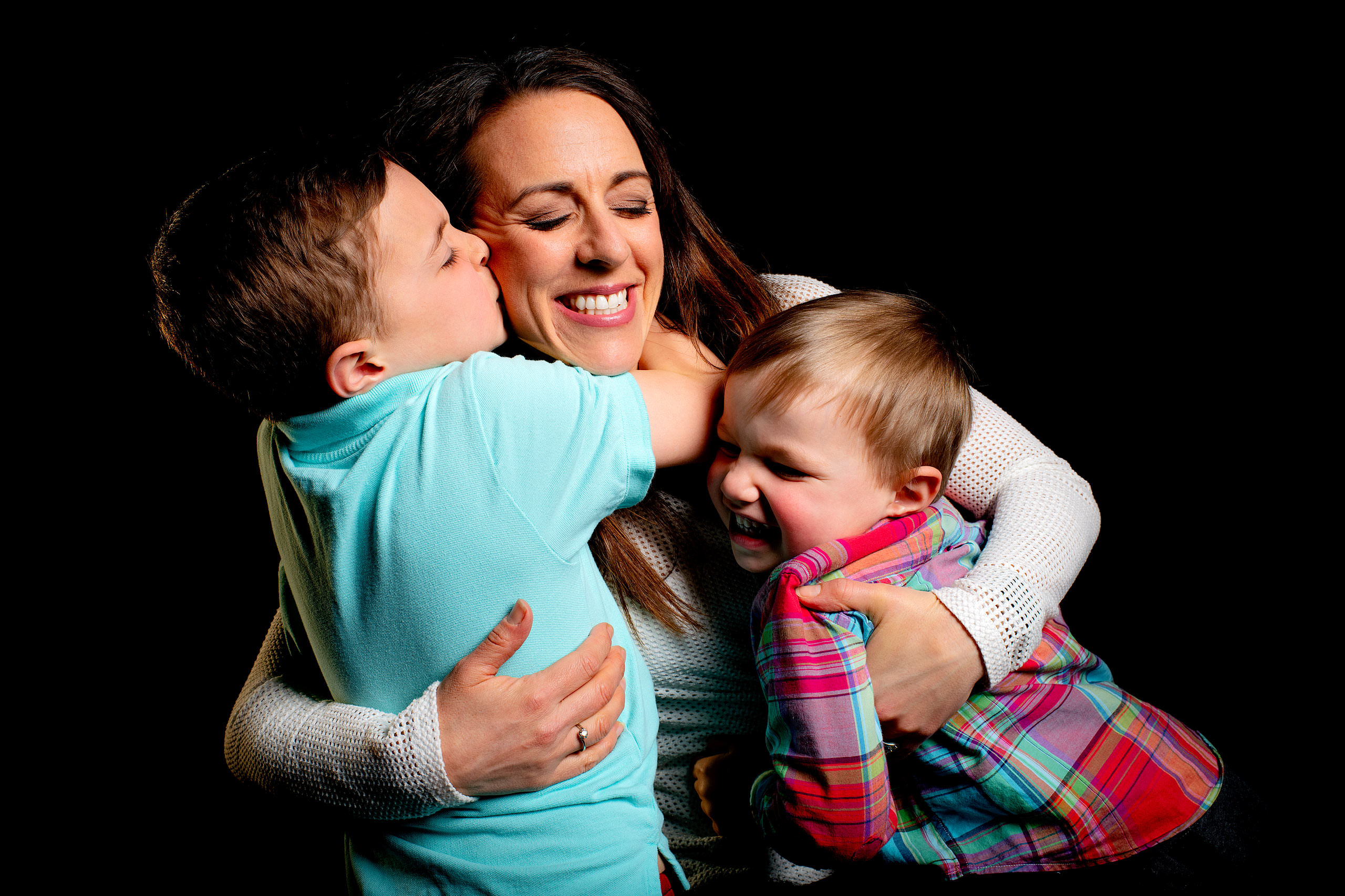 a mom with her boys smiling taken by family photographer sean leblanc