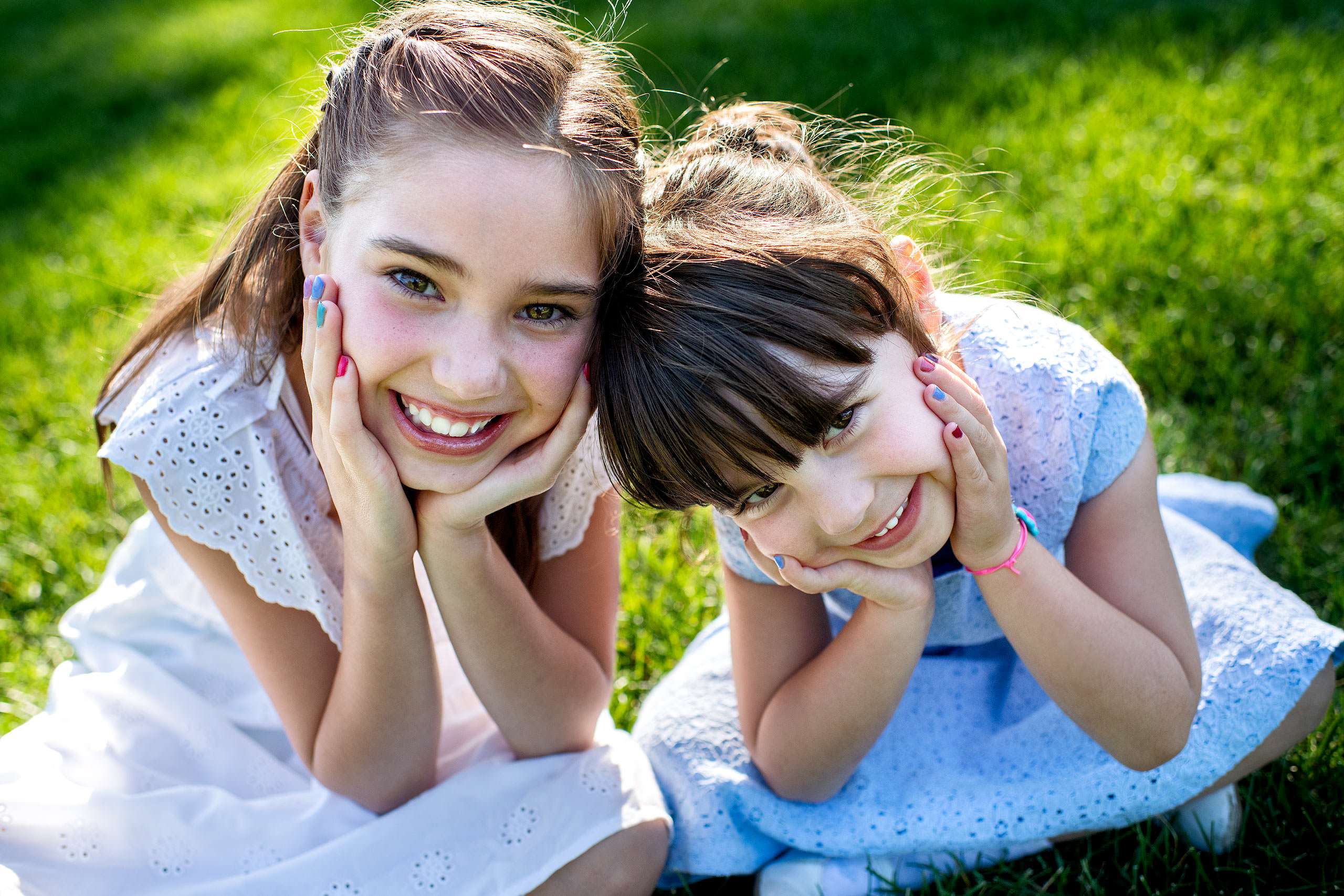 two young girls smiling together taken by family photographer sean leblanc