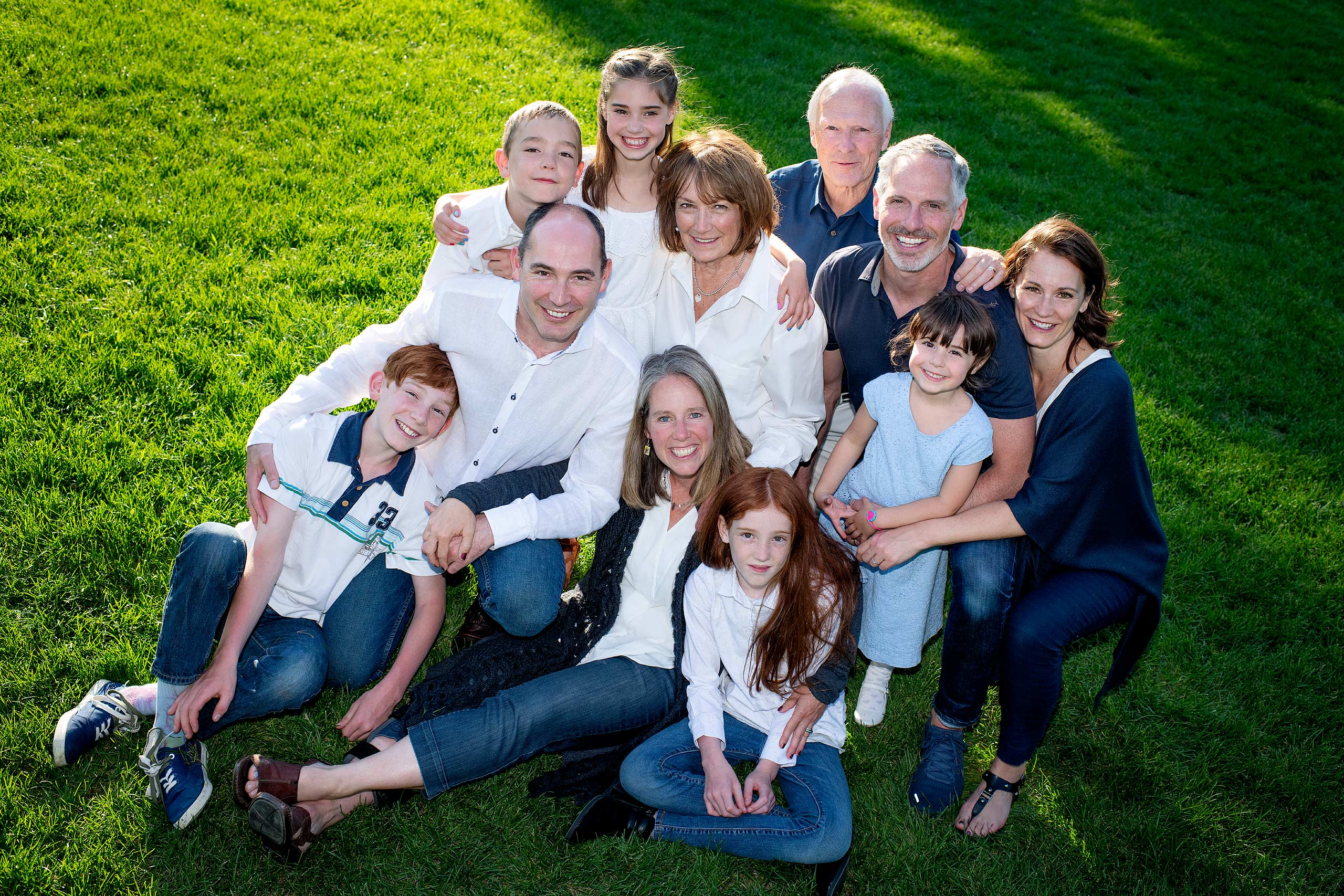 large family posing on the grass taken by family photographer sean leblanc