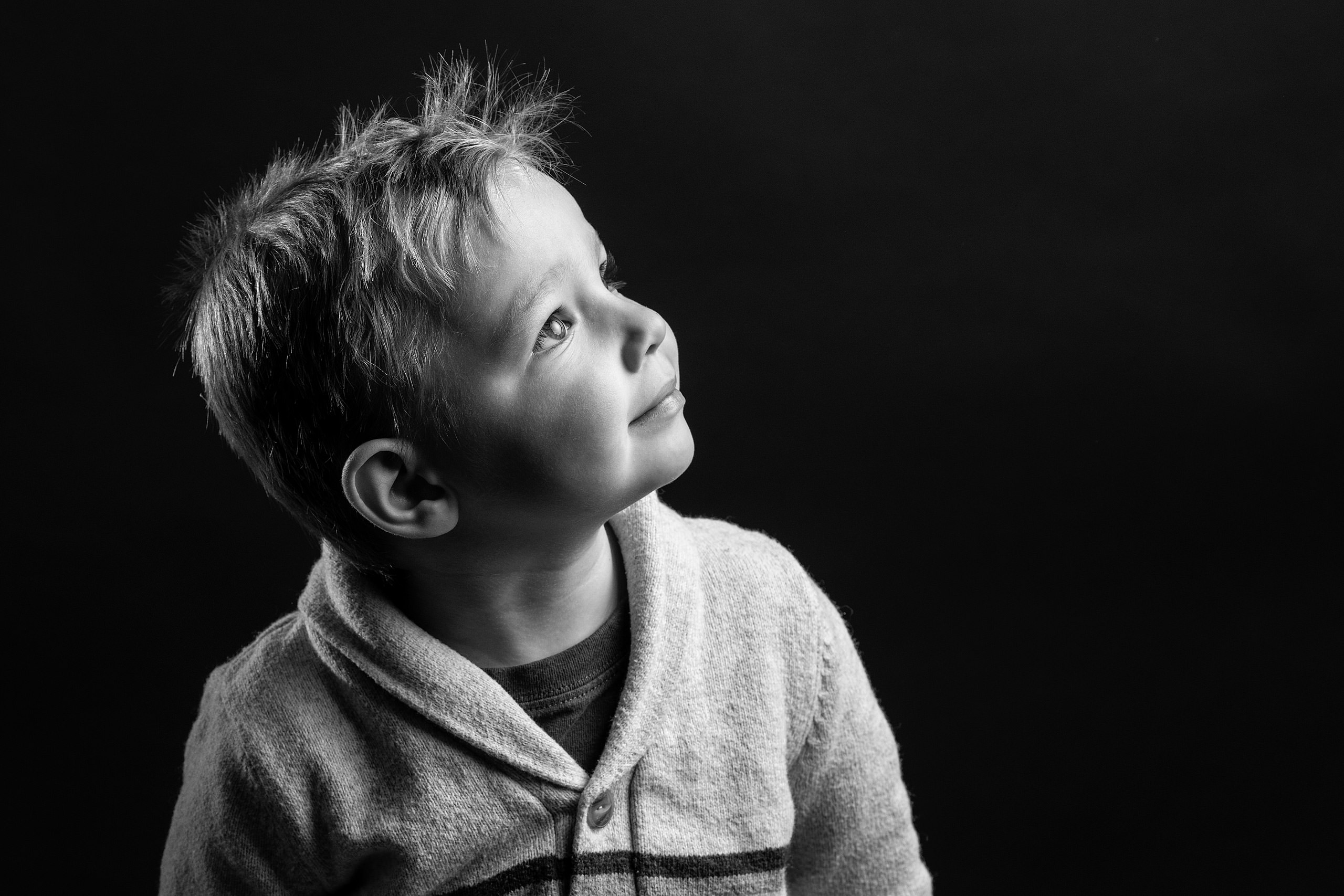 young boy looking up in studio taken by family photographer sean leblanc